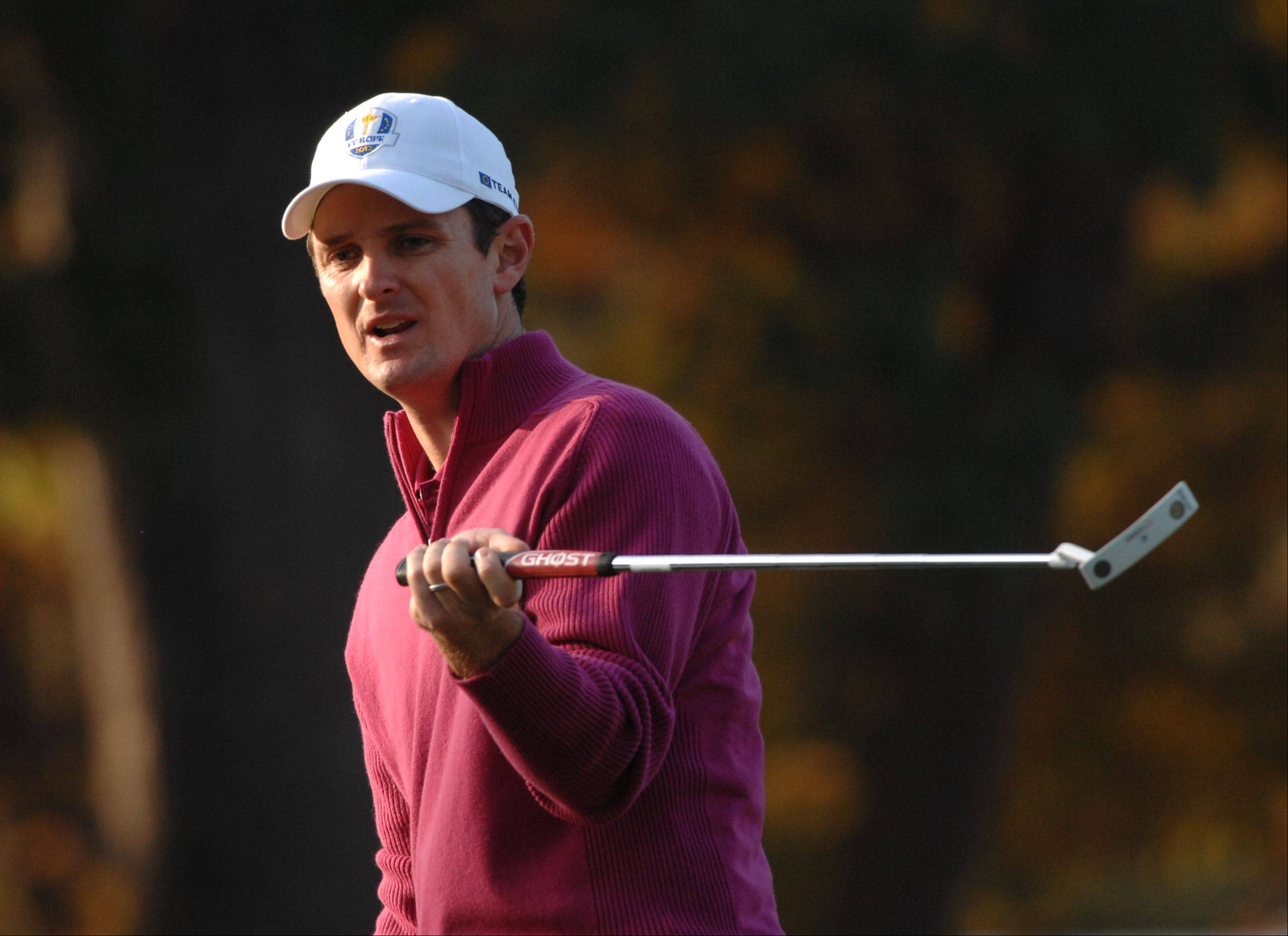 Justin Rose reacts to missing a putt on the ### hole Saturday morning during day 2 of the 2012 Ryder Cup at Medinah Country Club.