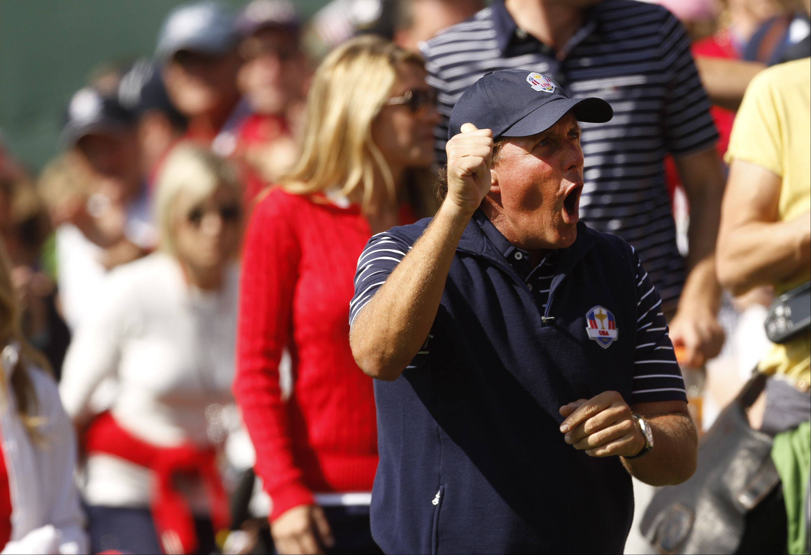 Phil Mickelson tries to pump up the crowd at the 17th hole Saturday morning during day 2 of the 2012 Ryder Cup at Medinah Country Club.