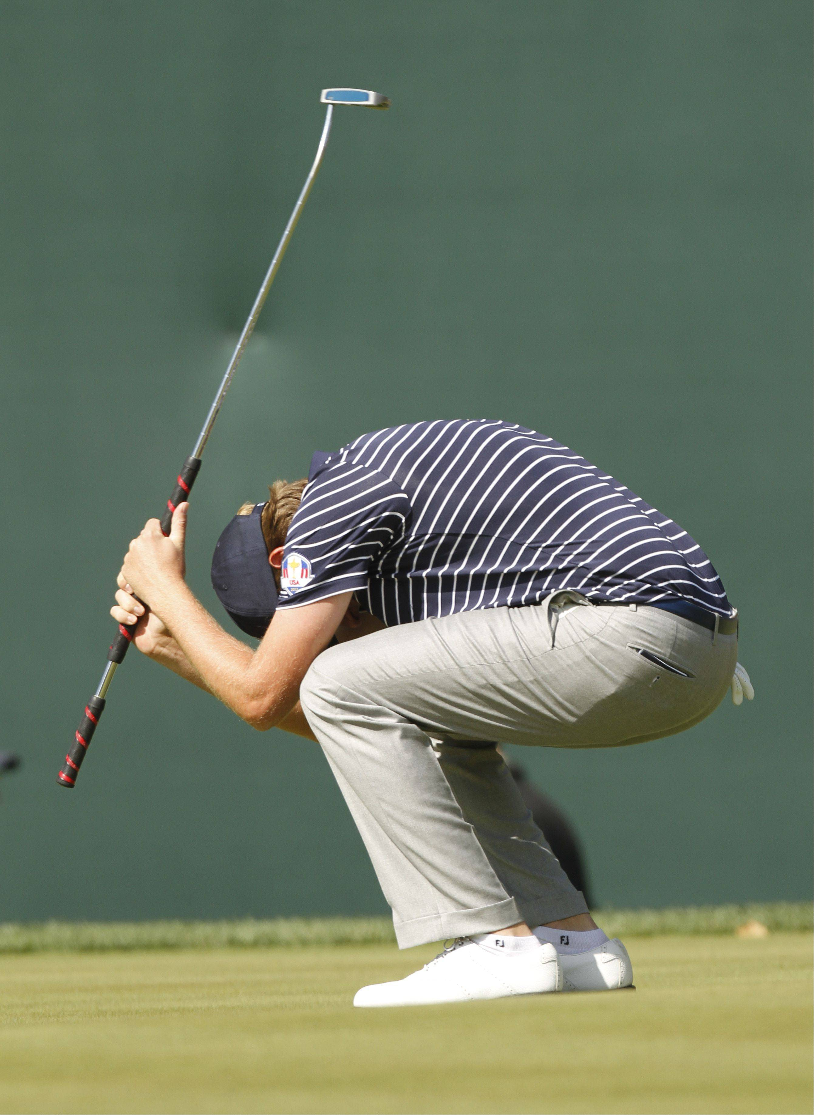 Webb Simpson reacts after missing his birdie putt on the 18th hole Saturday morning during day 2 of the 2012 Ryder Cup at Medinah Country Club.
