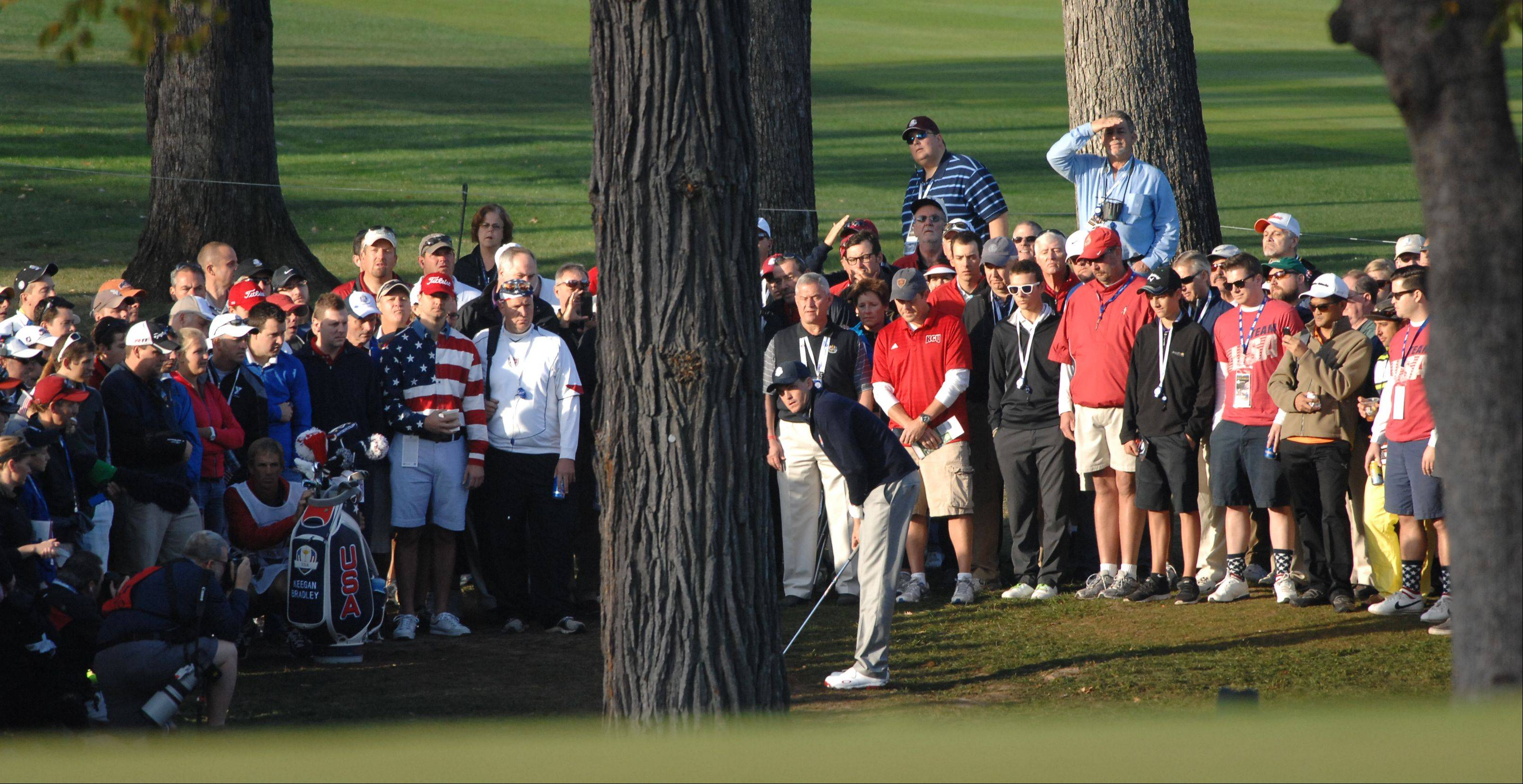 Keegan Bradley hitting from the rough on hole 4 Saturday morning during day 2 of the 2012 Ryder Cup at Medinah Country Club.
