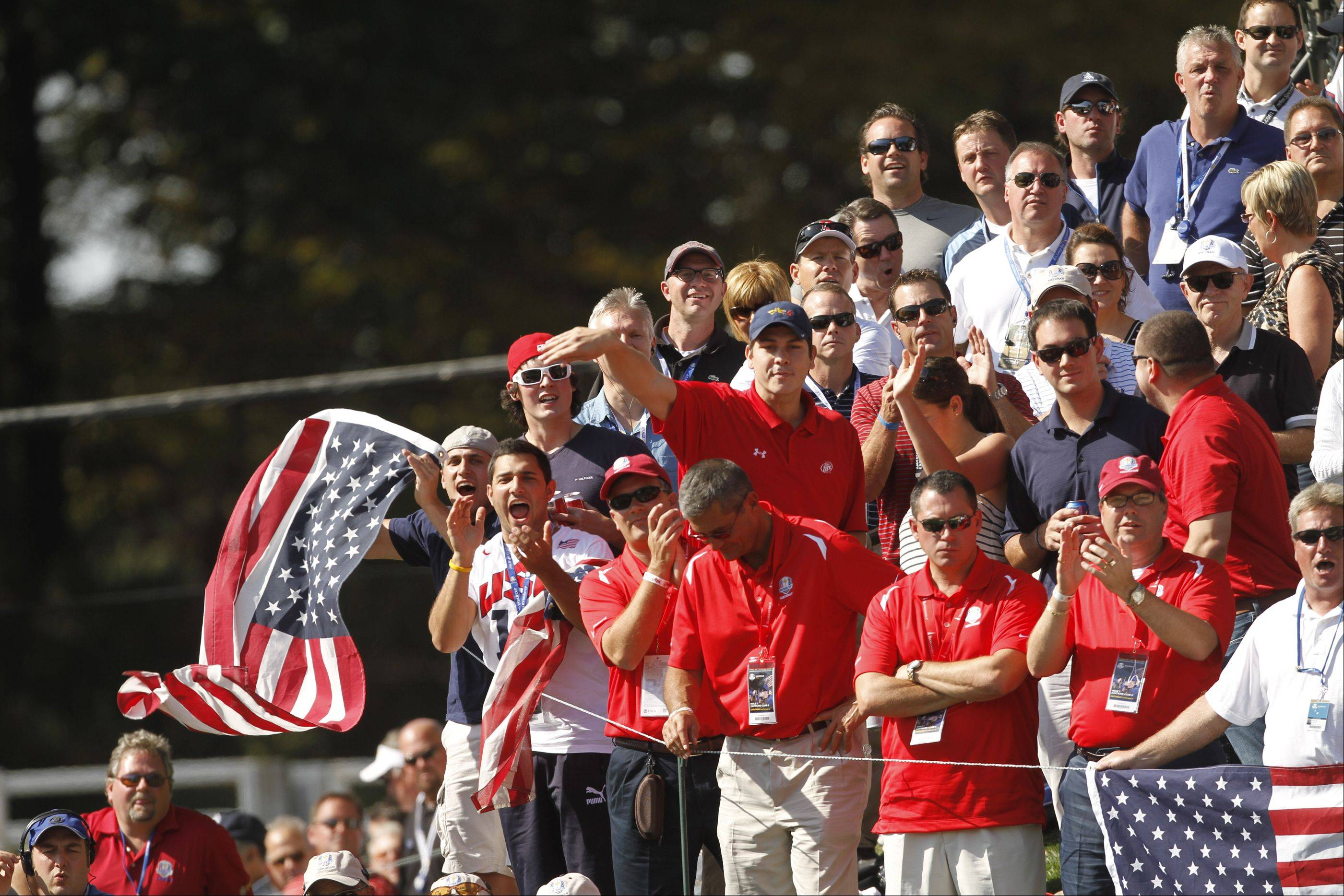 US fans react after Ian Poulter missed his birdie putt on the 17th hole Saturday morning during day 2 of the 2012 Ryder Cup at Medinah Country Club.