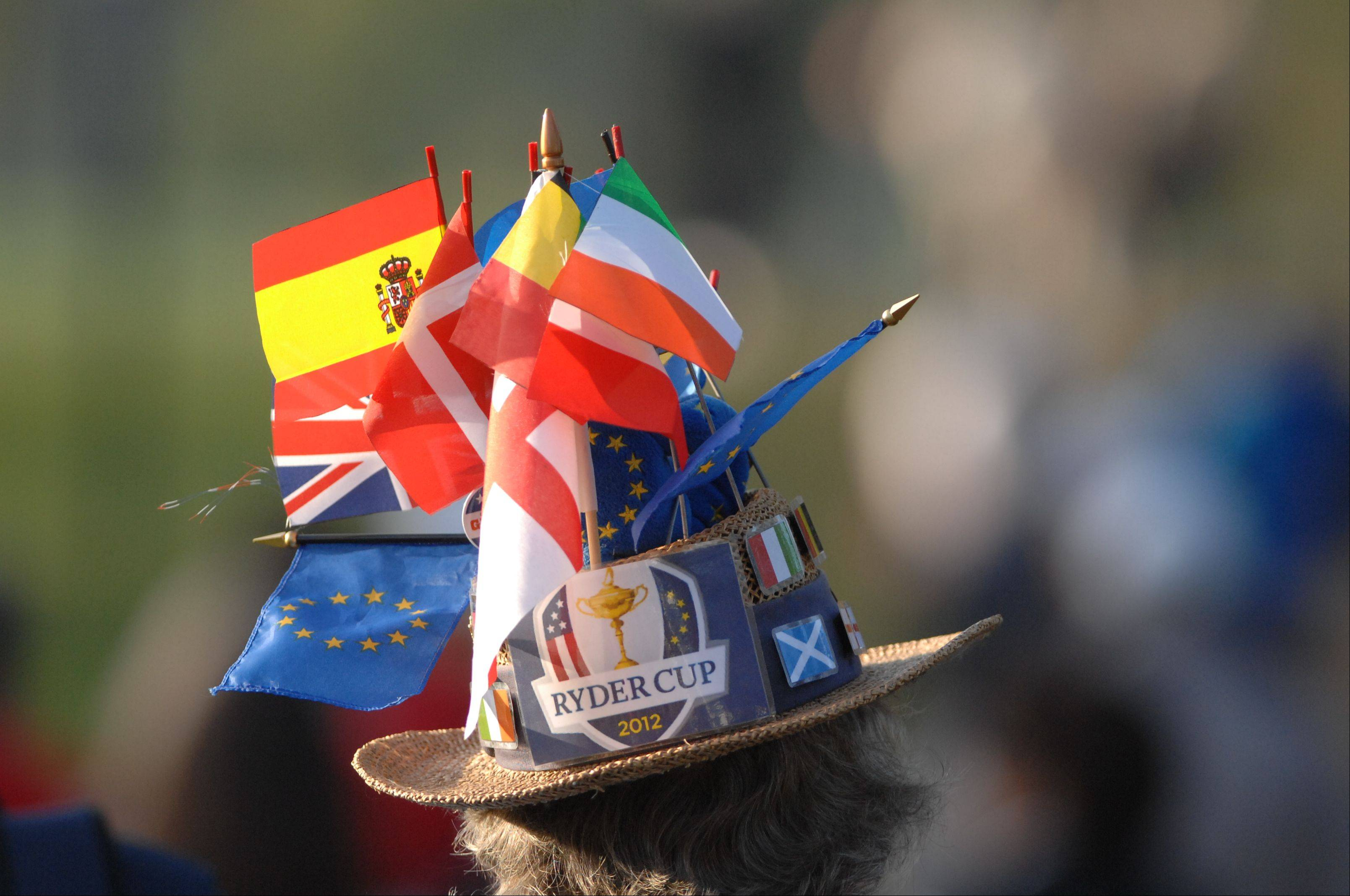 A fan of the European team has the flags of many European countries in his has as a show of support for their team during day 2 of the 2012 Ryder Cup at Medinah Country Club.
