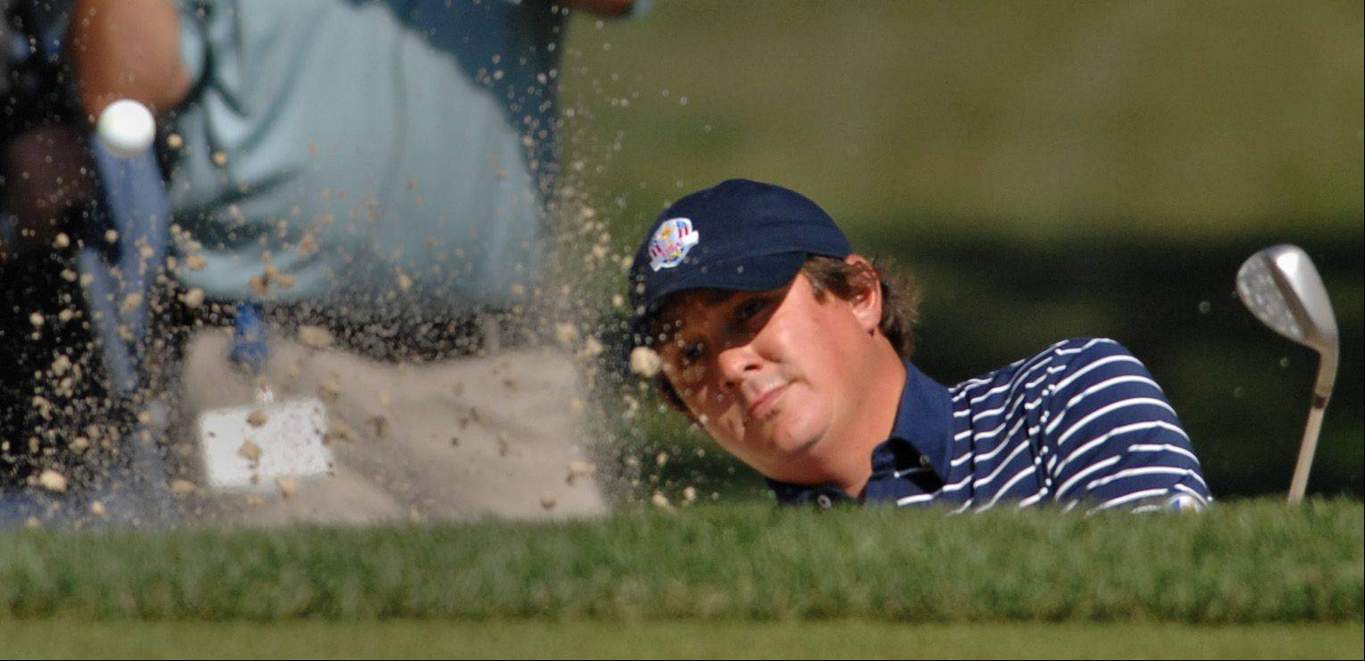 Jason Dufner blasts out of a bunker on 14.