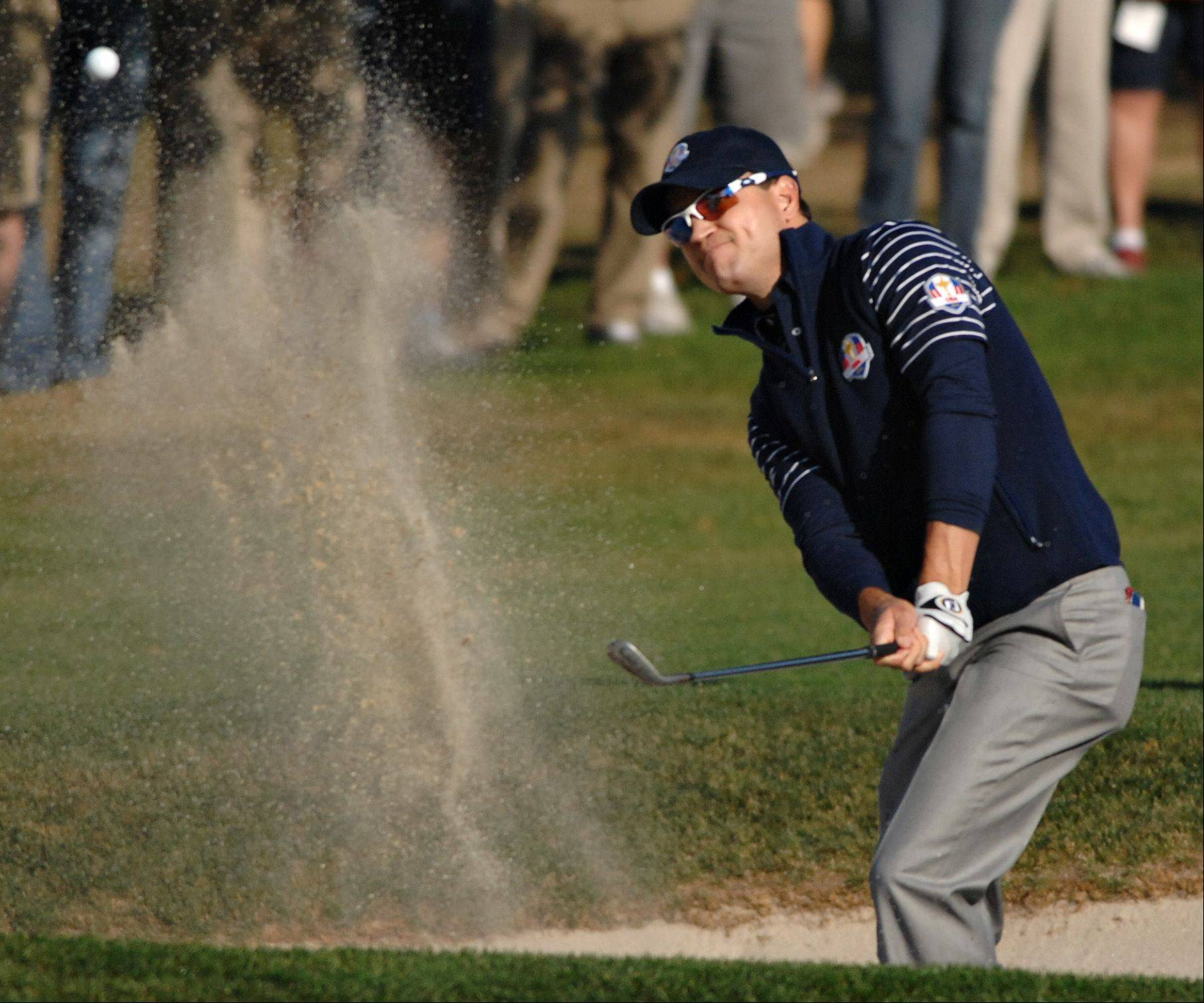 Zach Johnson blasts of out a bunker on the sixth hole Saturday.