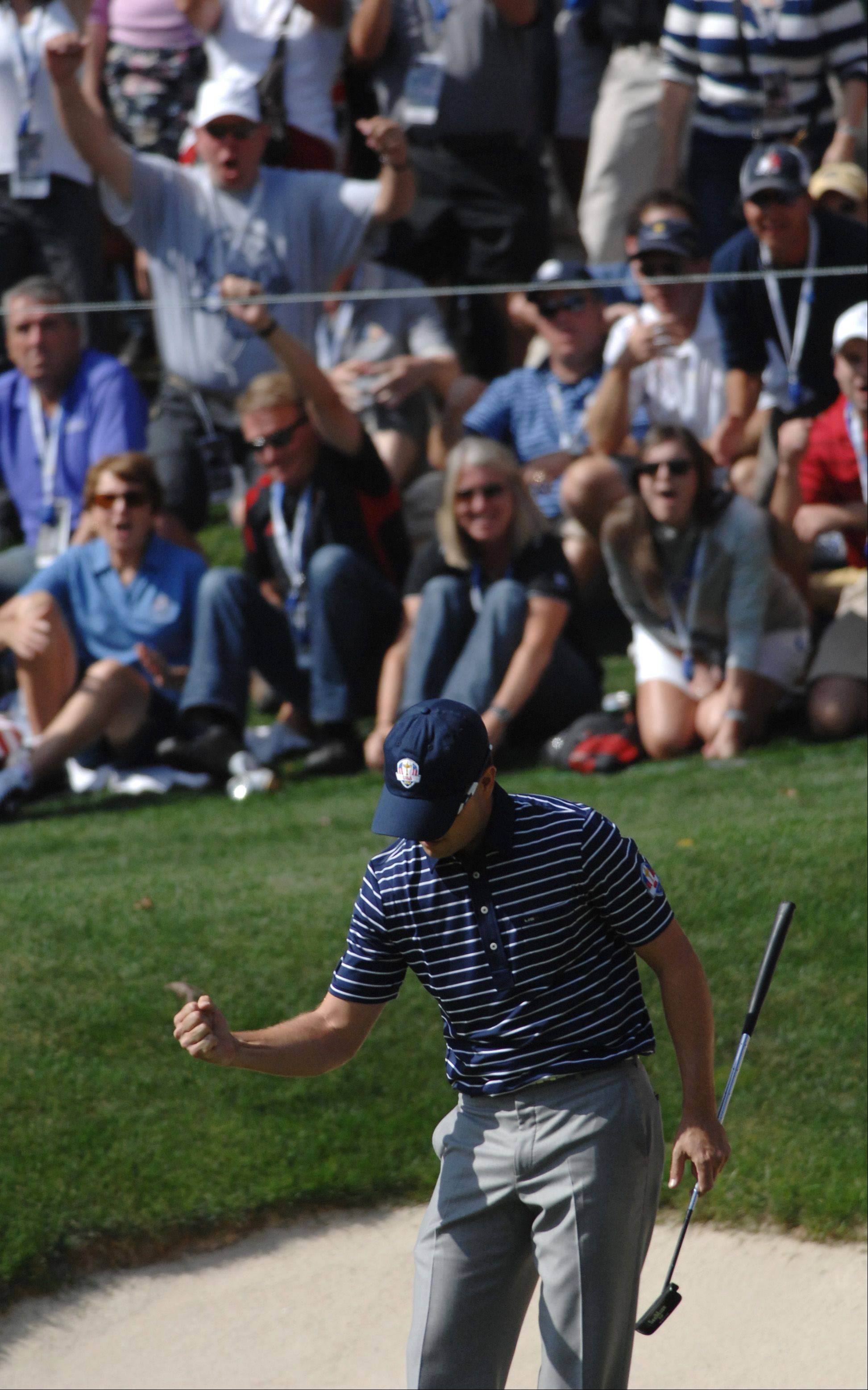 Zach Johnson reacts to a great putt on 17 that helped the US team win the hole.