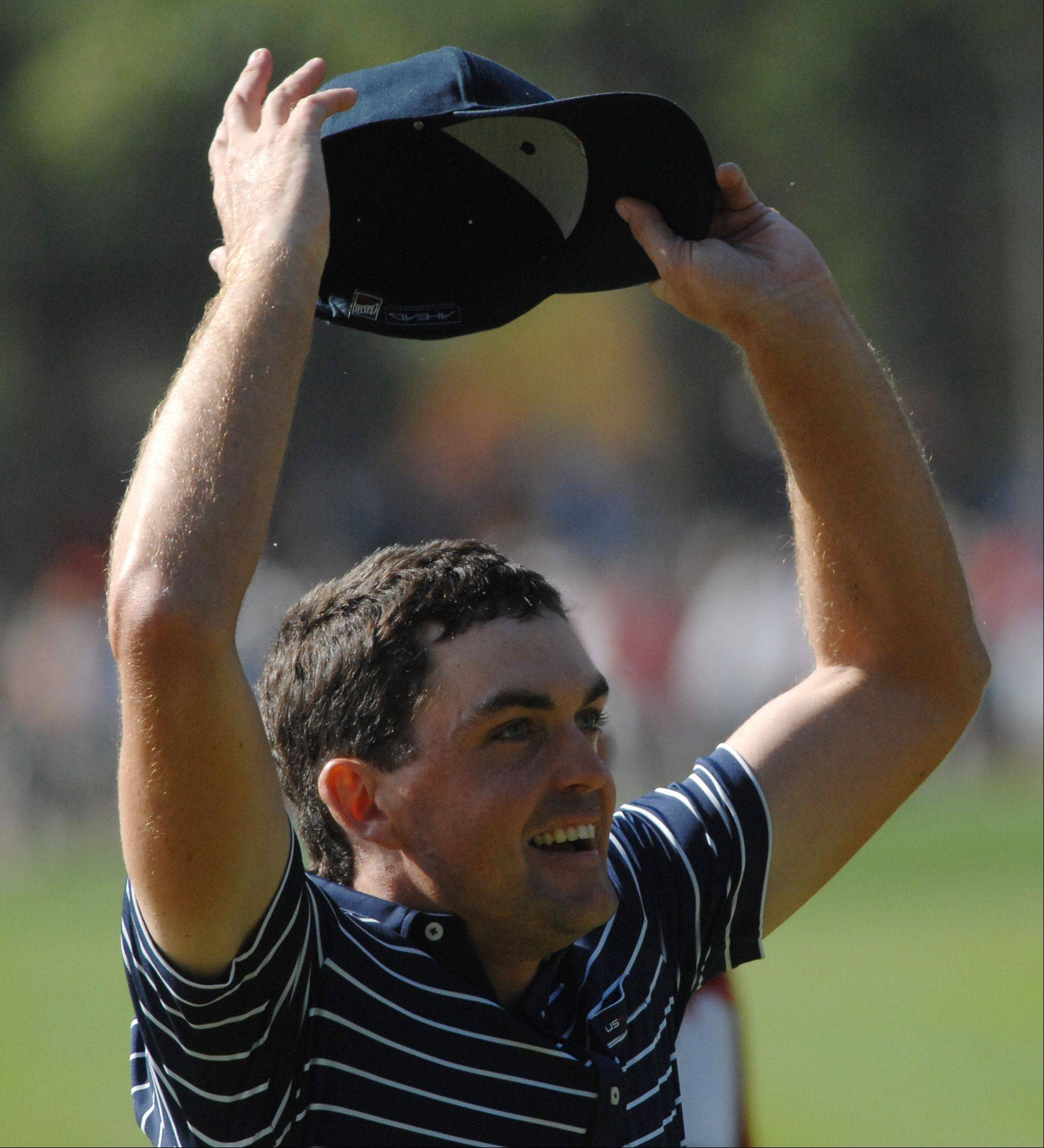 Keegan Bradley celebrates his team's win Saturday during the foursome matches at Medinah.