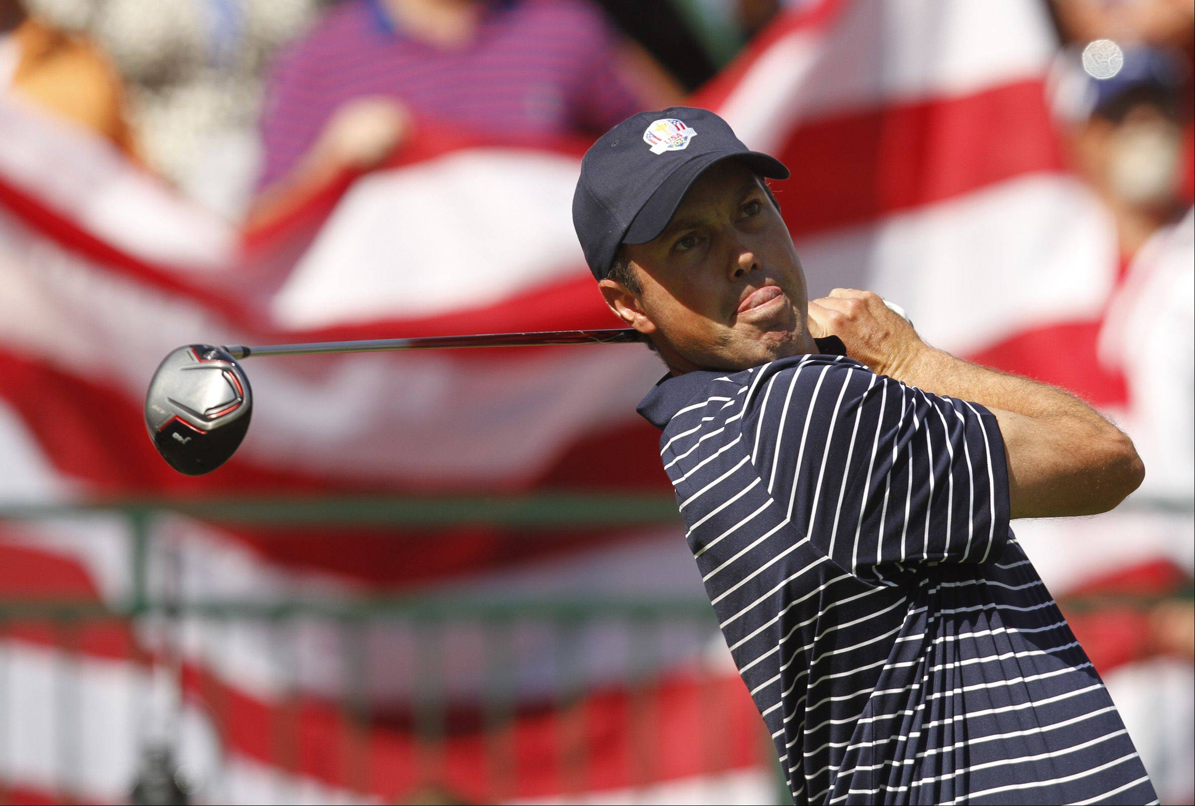 Team USA's Matt Kuchar tees off with Old Glory behind him Saturday afternoon.