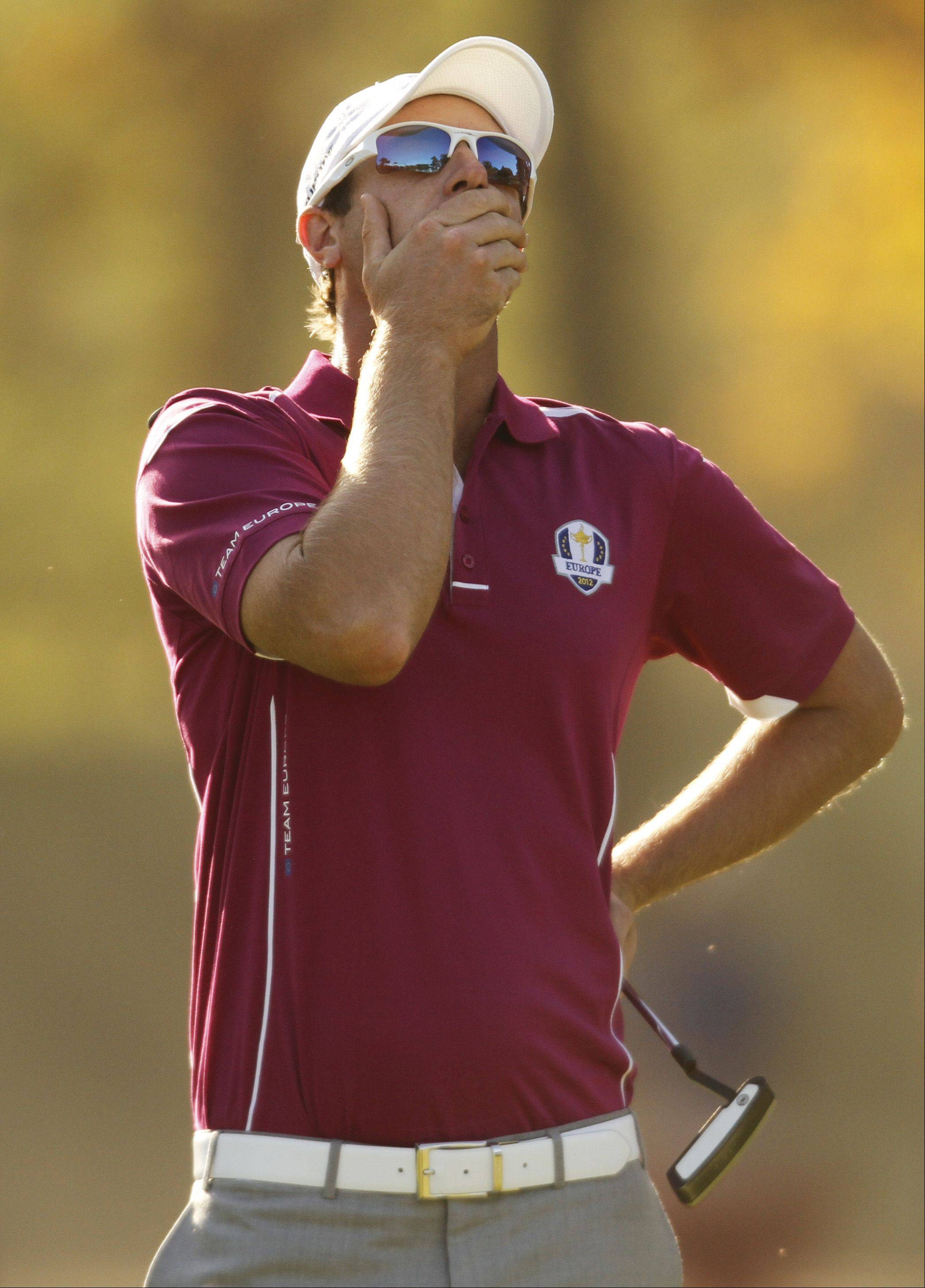 Team Europe's Nicolas Colsaerts is exasperated after a putt Saturday on #14.