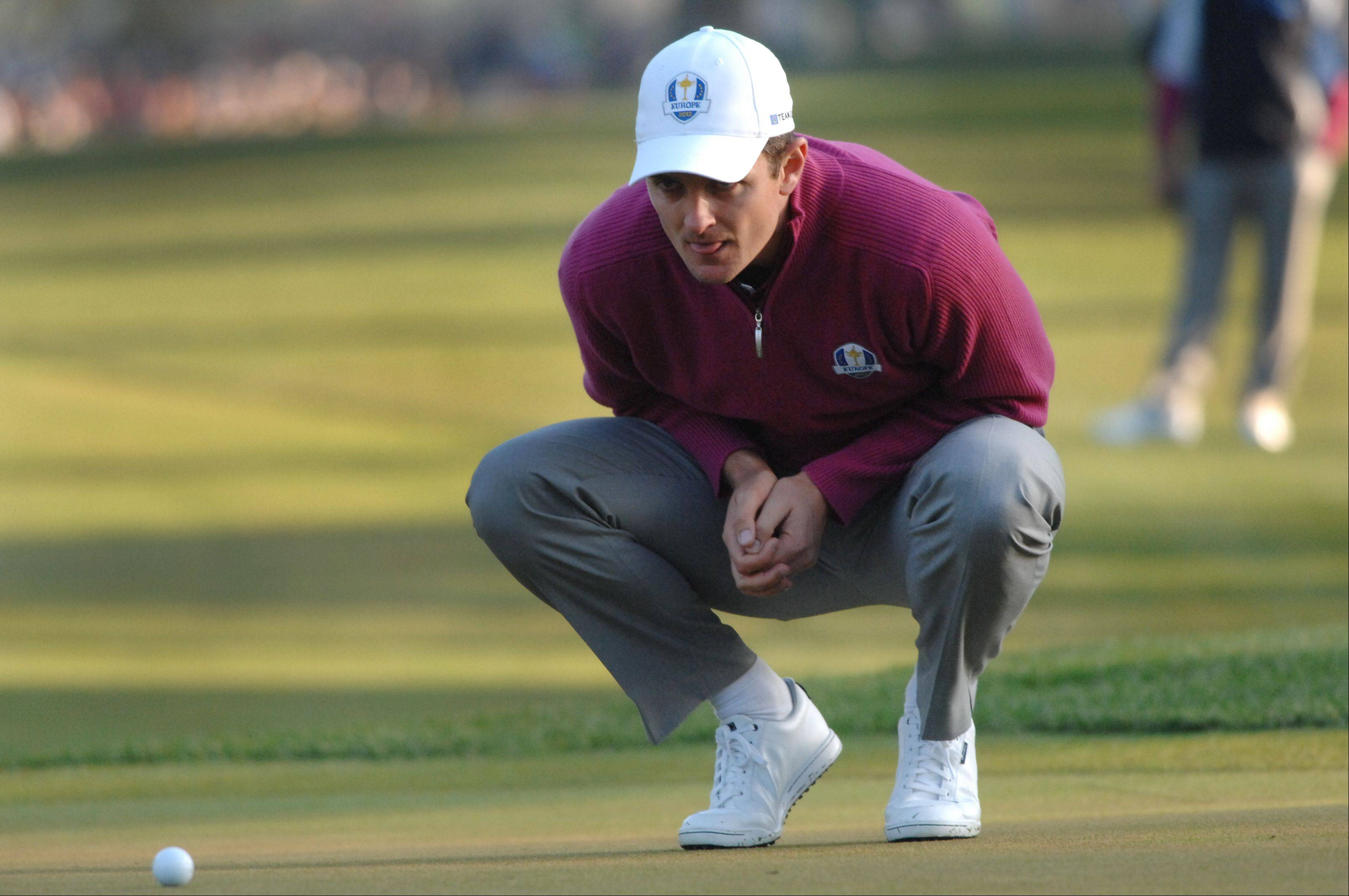 Justin Rose of team Europe lines up his putt on the first hole Saturday morning during day 2 of the 2012 Ryder Cup at Medinah Country Club.