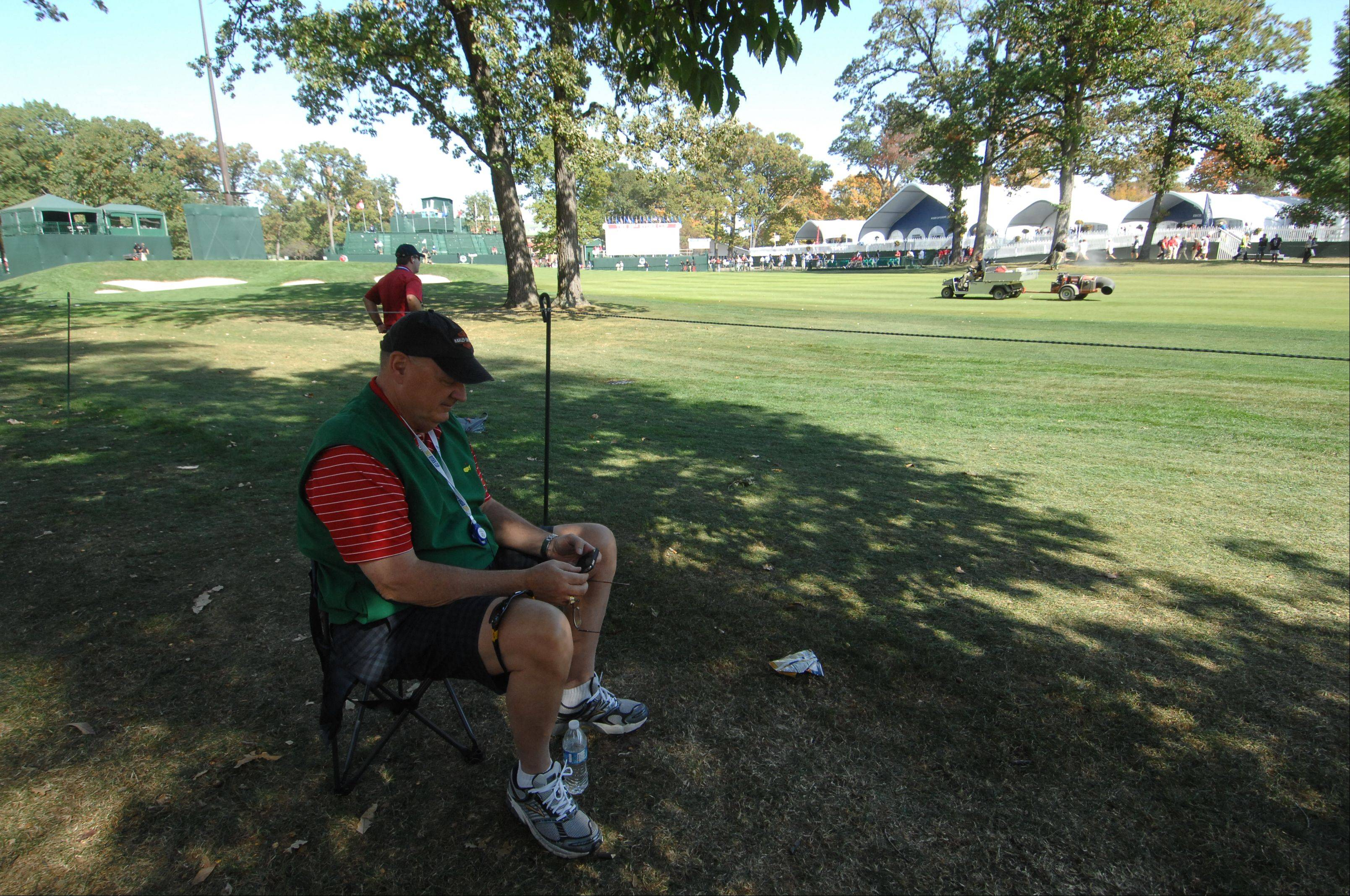 "Chris Kingery from Lincoln, Neb., staked out a good spot on the 18th hole a few hours before Ryder Cup action would arrive. Kingery said, ""I figure they've got to come by eventually."""
