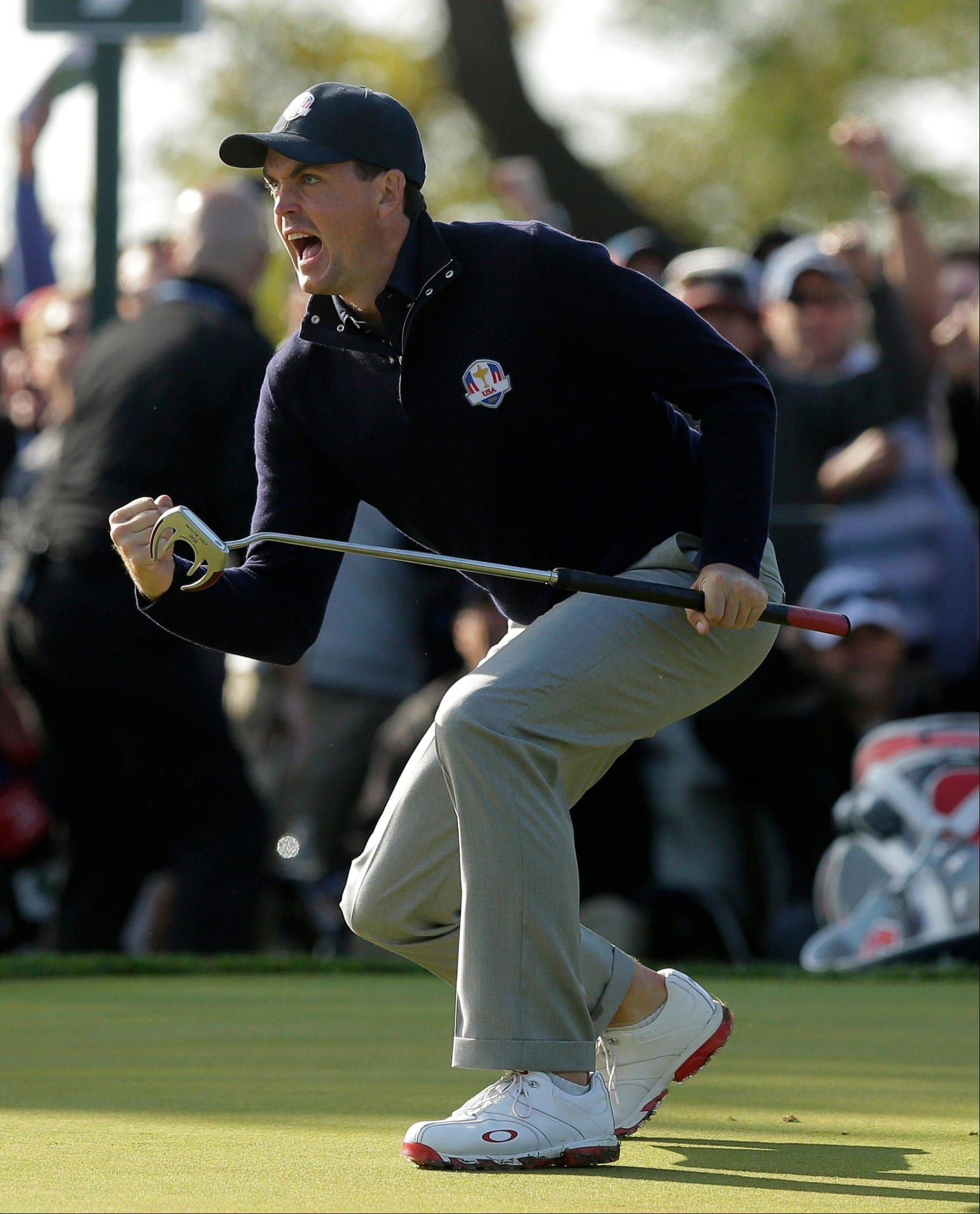USA's Keegan Bradley reacts after making a putt on the ninth hole during a foursomes match at the Ryder Cup Saturday at Medinah Country Club. Bradley and Phil Mickelson led the charge as Team USA grabbed an 8-4 lead before the afternoon matches.