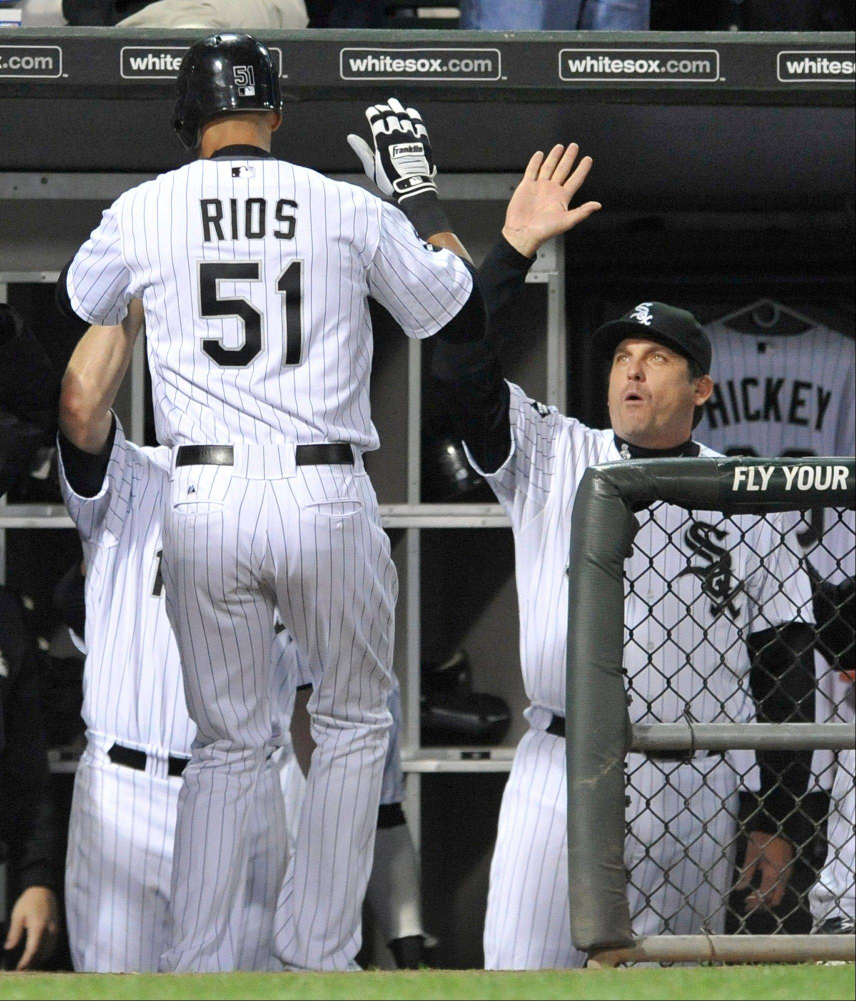 The White Sox' Alex Rios is greeted in the dugout after hitting the go-ahead run in the fourth inning.