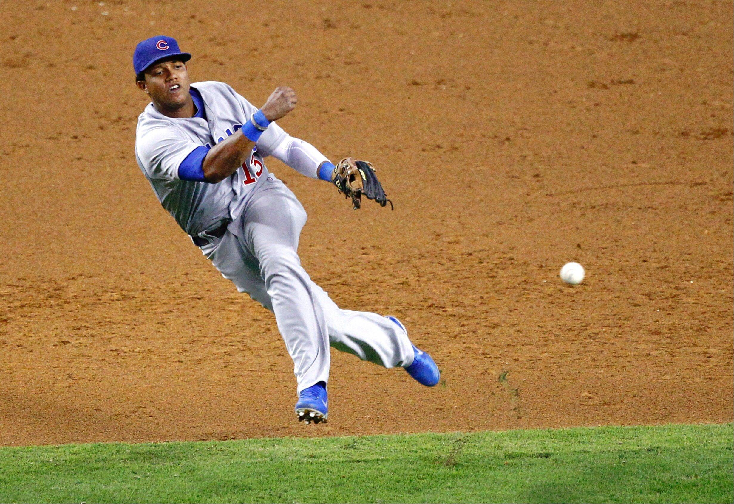 Chicago Cubs' Starlin Castro can't throw out Arizona Diamondbacks' Chad Eaton during the eighth inning of a baseball game, Friday, Sept. 28, 2012,in Phoenix.