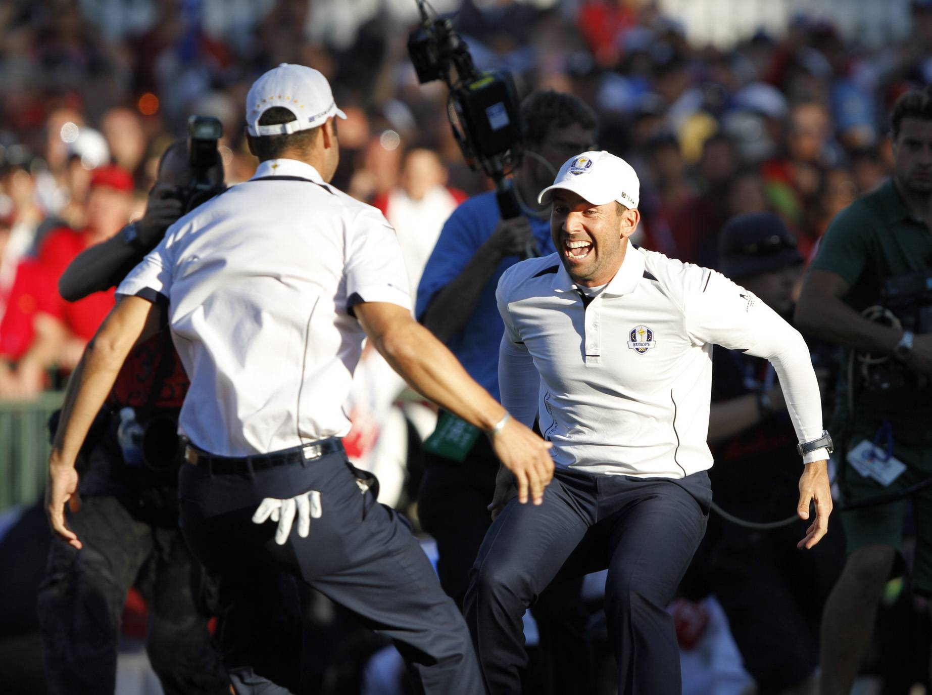 Sergio Garcia, right, and Martin Kaymer celebrate after Kaymer sank the put that sealed the Ryder Cup victory Sunday during the final day of the 2012 Ryder Cup at Medinah Country Club.