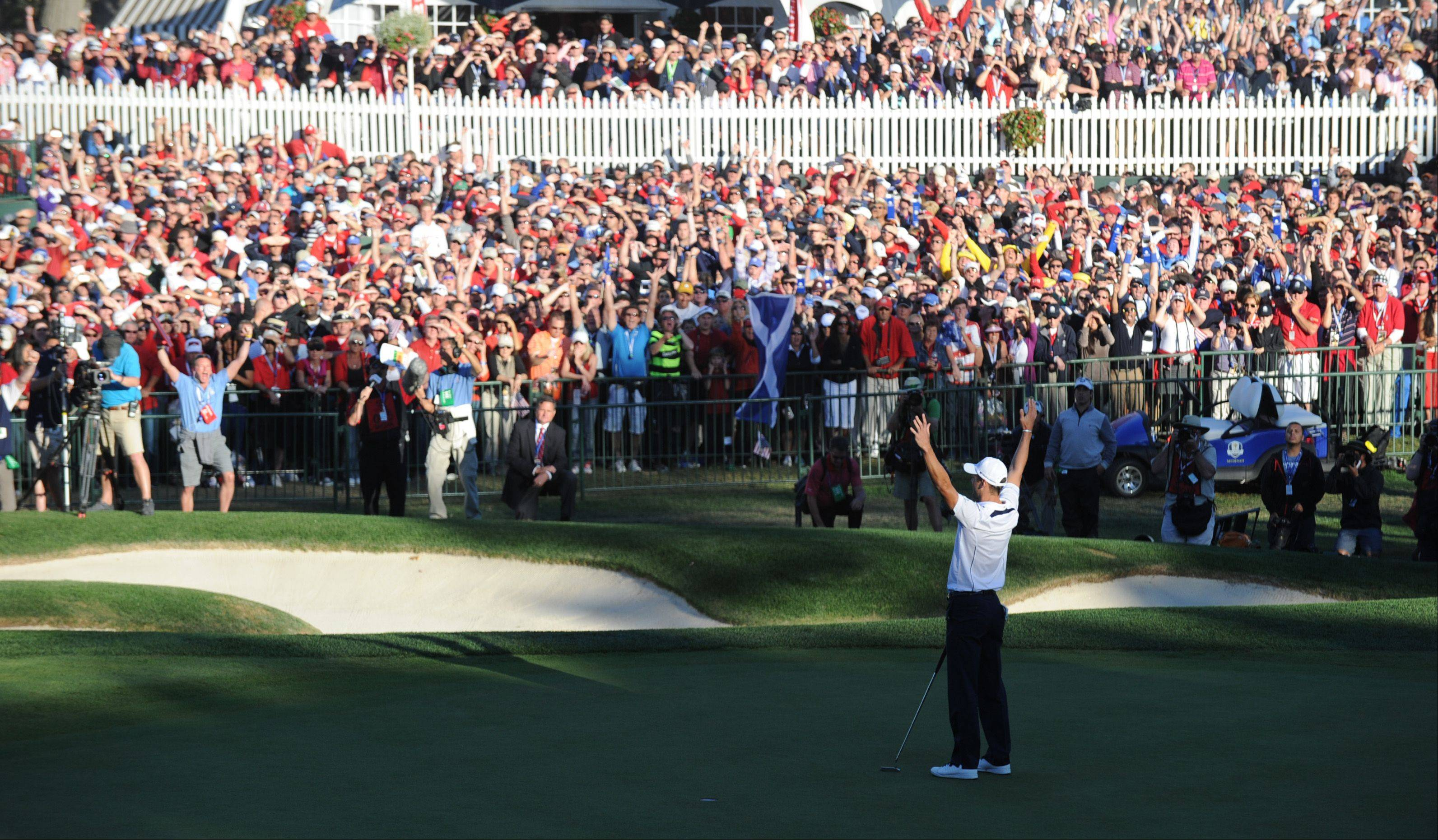 Martin Kaymer of Team Europe raises his arms in victory after his par putt on 18 clinched the 2012 Ryder Cup for Europe.