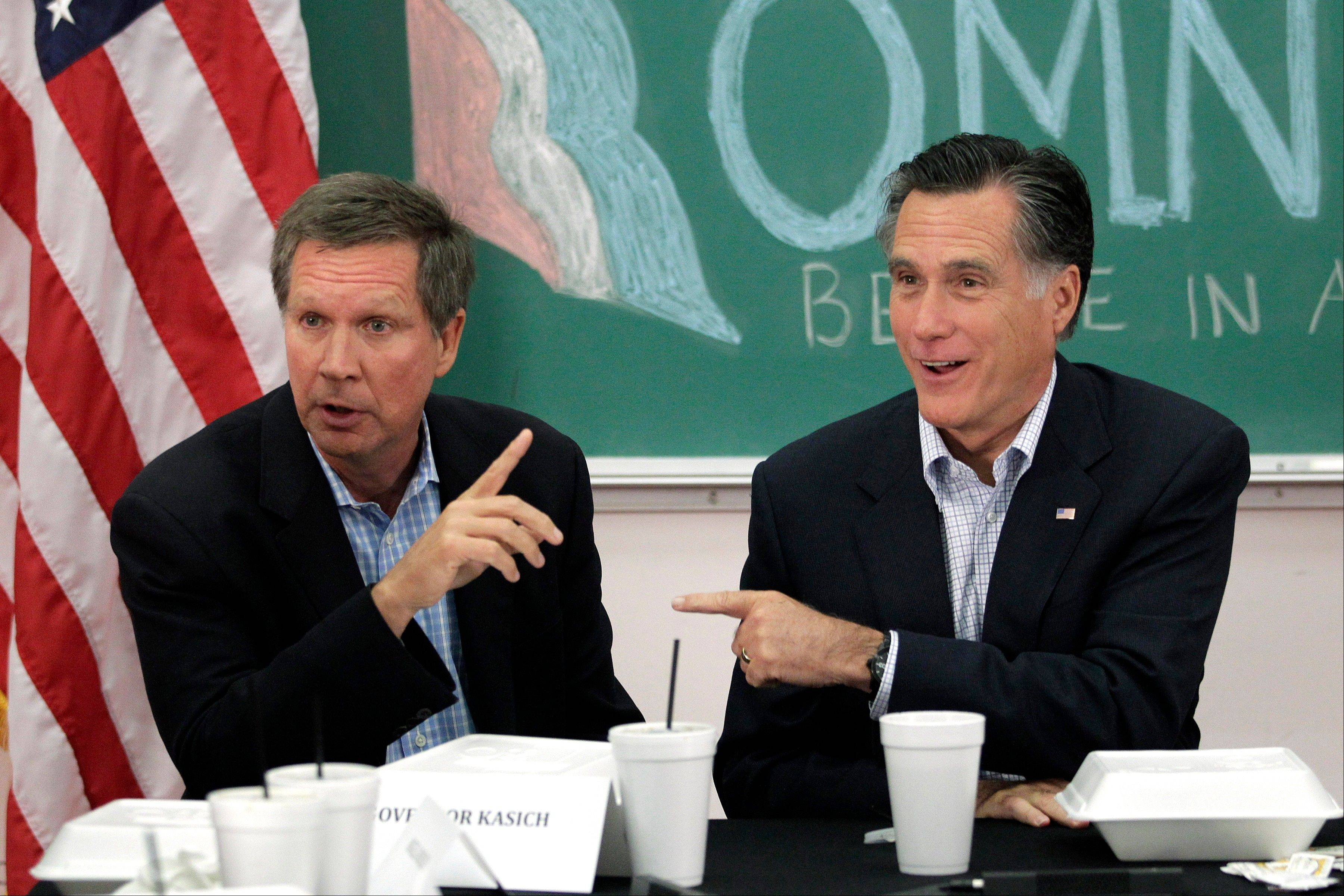 Republican presidential candidate and former Massachusetts Gov. Mitt Romney and Ohio Gov. John Kasich participate in a round-table discussion in Westerville, Ohio. President Barack Obama and his supporters point to the U.S. auto comeback and a manufacturing rebirth. Kasich lauded his own policies in a speech at the GOP convention, noting he'd erased a projected $8 billion deficit without a statewide tax increase and Ohio has moved from 48th to 4th in job creation. His office says 122,500 jobs have been created since he took office in January 2011.