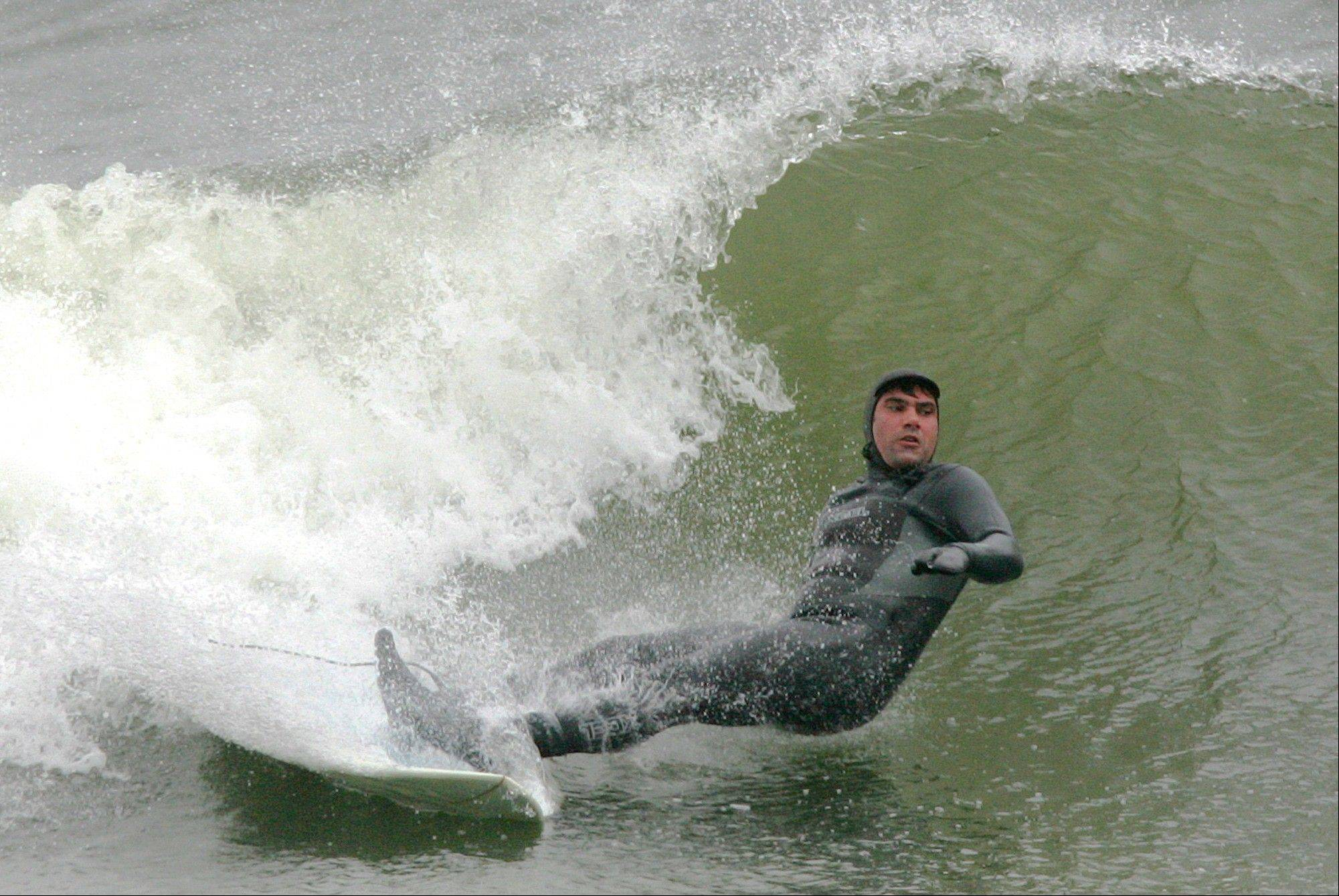 A surfer is seen off the coast line in Hampton, N.H. When the weather gets bad the surfing gets great.