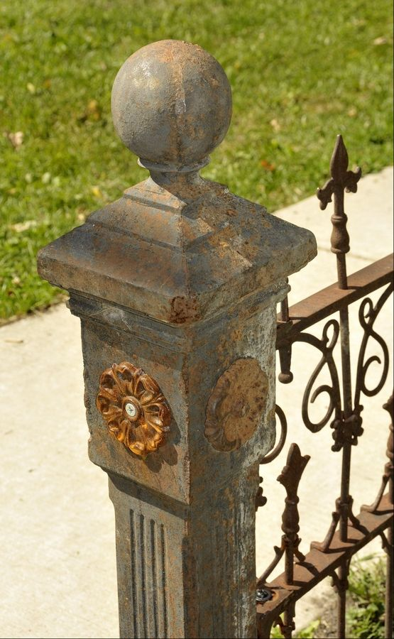 Ironworker Fred Gebbia restored this original wrought iron fence from the 1880s for a client in Wayne. What looks like rust, is actually a patina that develops naturally on wroght iron, which doesn't rust. Sometimes modern materials must be used for repairs, such as for the left rosette on this end post. The right rosette is original.