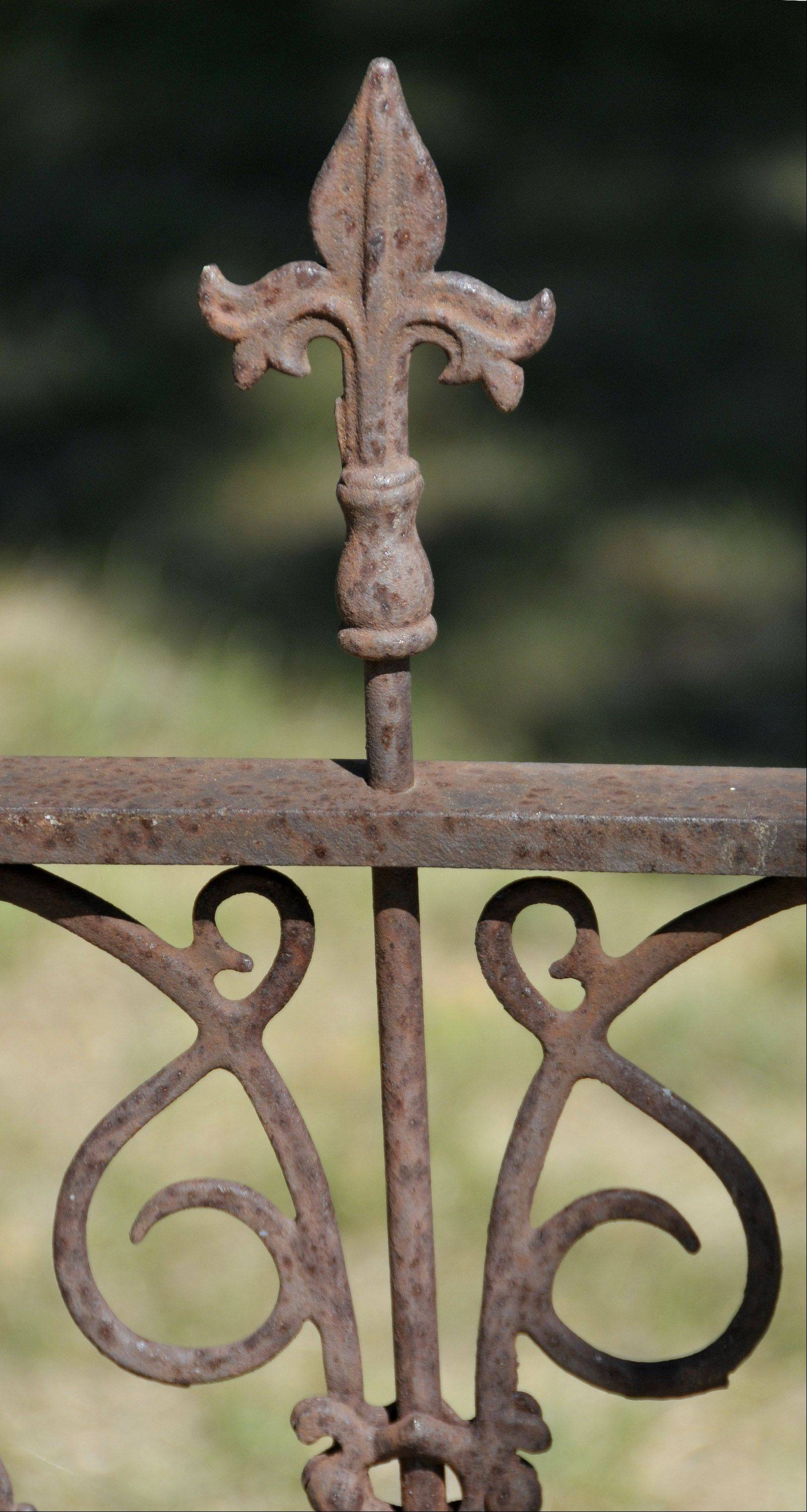 Ironworker Fred Gebbia repaired and installed this original wrought iron fence from the 1880s for a client in Wayne.