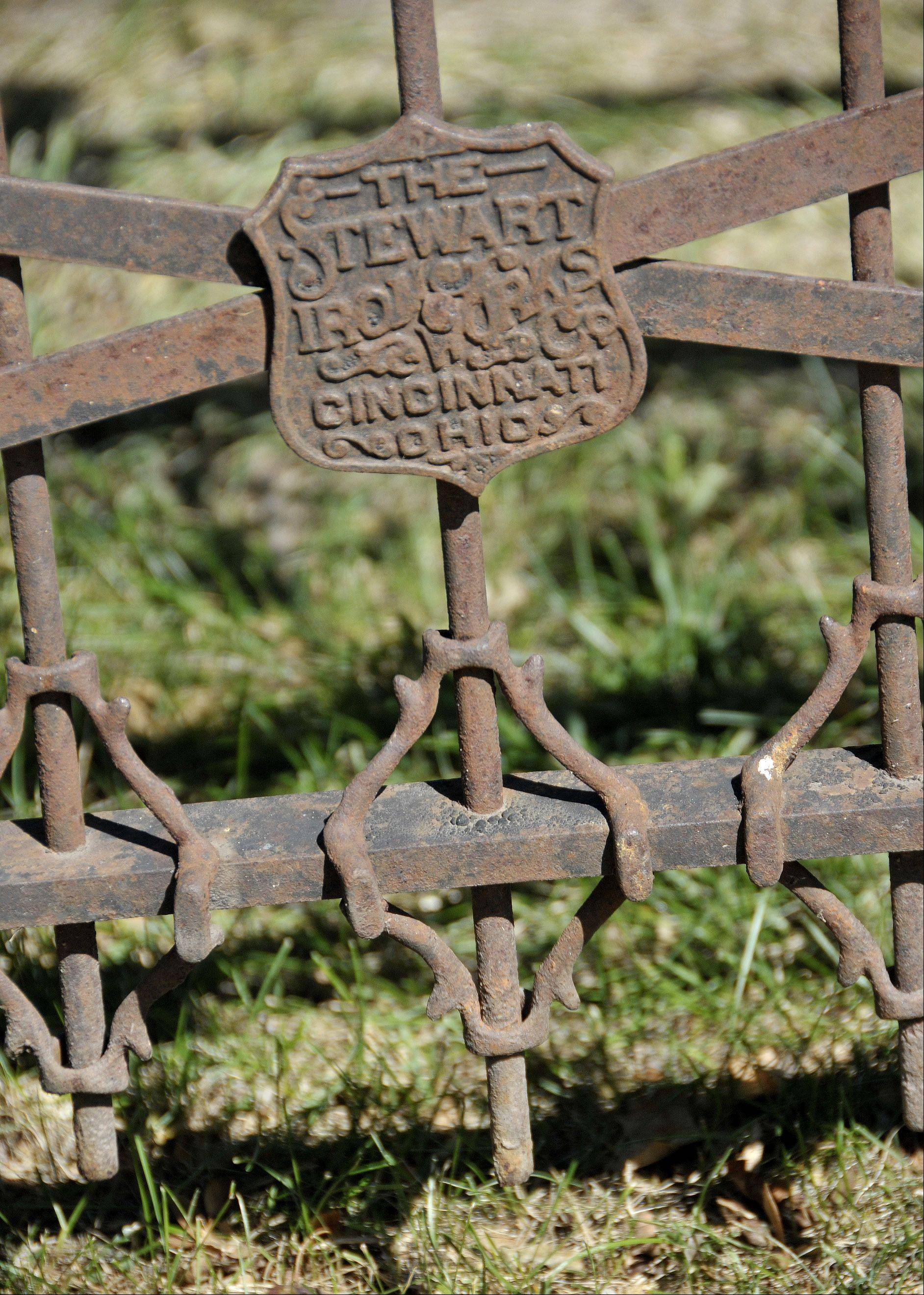 The 1800s fence was originally manufactured by Stewart Iron Works, a company that is still in business