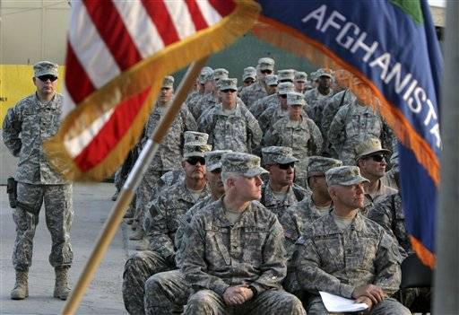 In this Sept 11, 2008 file photograph, US soldiers attend a ceremony marking the 7th anniversary of the Sept. 11 attacks, at the U.S Camp Phoenix in Kabul, Afghanistan. .U.S. military deaths in Afghanistan have surpassed 2,000.