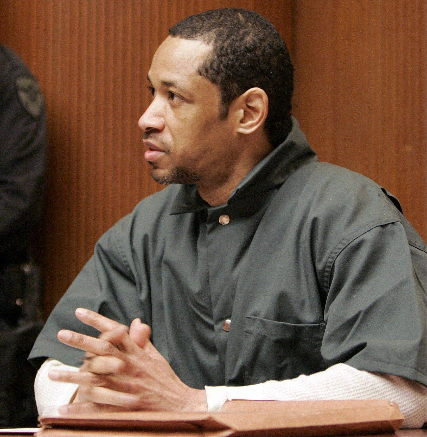 In this Friday, April 28, 2006 file photo, convicted sniper John Allen Muhammad addresses Judge James L. Ryan during a media preview before the start of his trial in Rockville, Md. Convicted D.C. sniper Lee Boyd Malvo, aka John Lee Malvo, said in a newspaper interview published Sunday, that the devastated reaction of a victim�s husband made him feel like �the worst piece of scum.� Malvo expresses remorse in the interview with The Washington Post and urged the families of victims to try and forget about him and his partner, Muhammad, so they can move on. Tuesday marks the 10th anniversary of the beginning of the deadly spree in the Washington area carried by Malvo and Muhammad. The pair have been linked to 27 shootings across the country, including 10 fatal attacks in the Washington area.