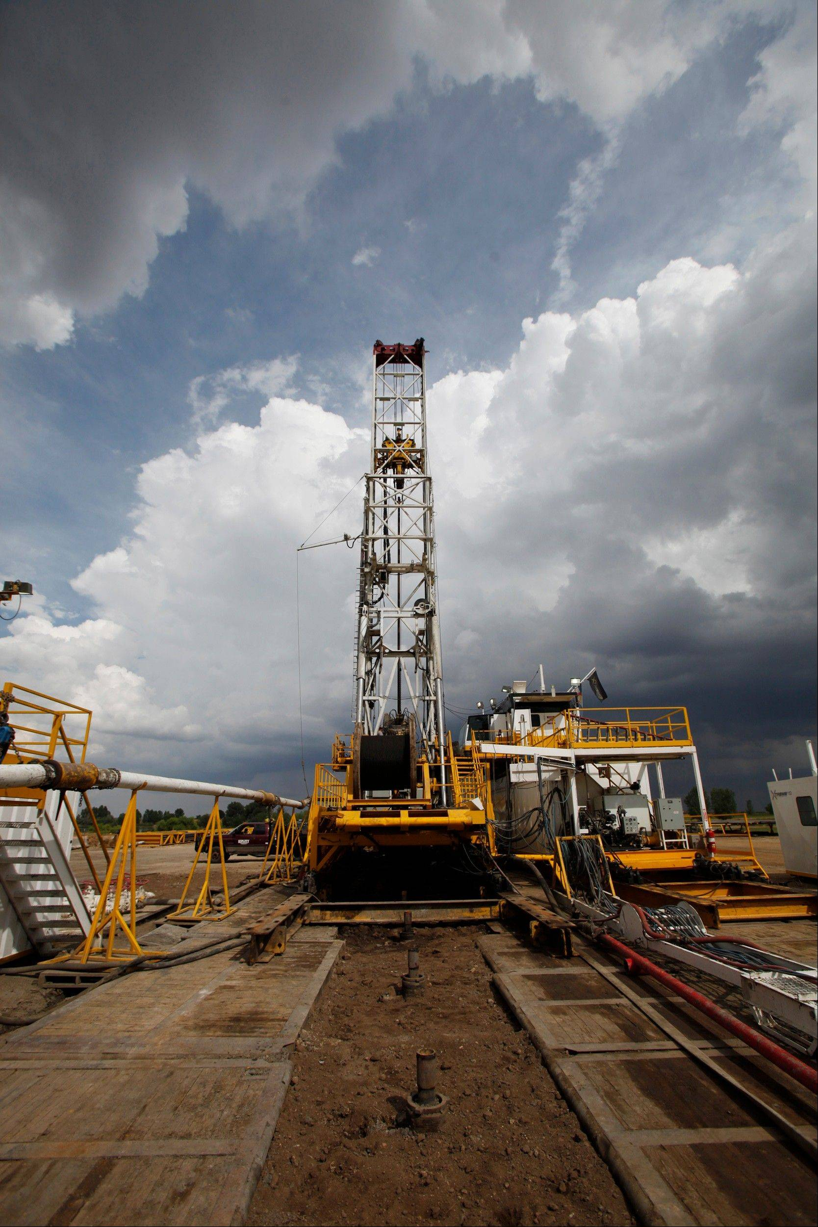 This Aug. 25, 2009. file photo shows capped wells in the foreground as Anadarko Petroleum Corp., drills a series of wells on a pad on a Weld County farm near Mead, Colo. in the northeastern part of the state. The drilling process called hydraulic fracturing, or fracking, is shaking up world energy markets from Washington to Moscow to Beijing. Some predict what was once unthinkable: that the U.S. won't need to import natural gas in the near future, and that Russia could be the big loser.
