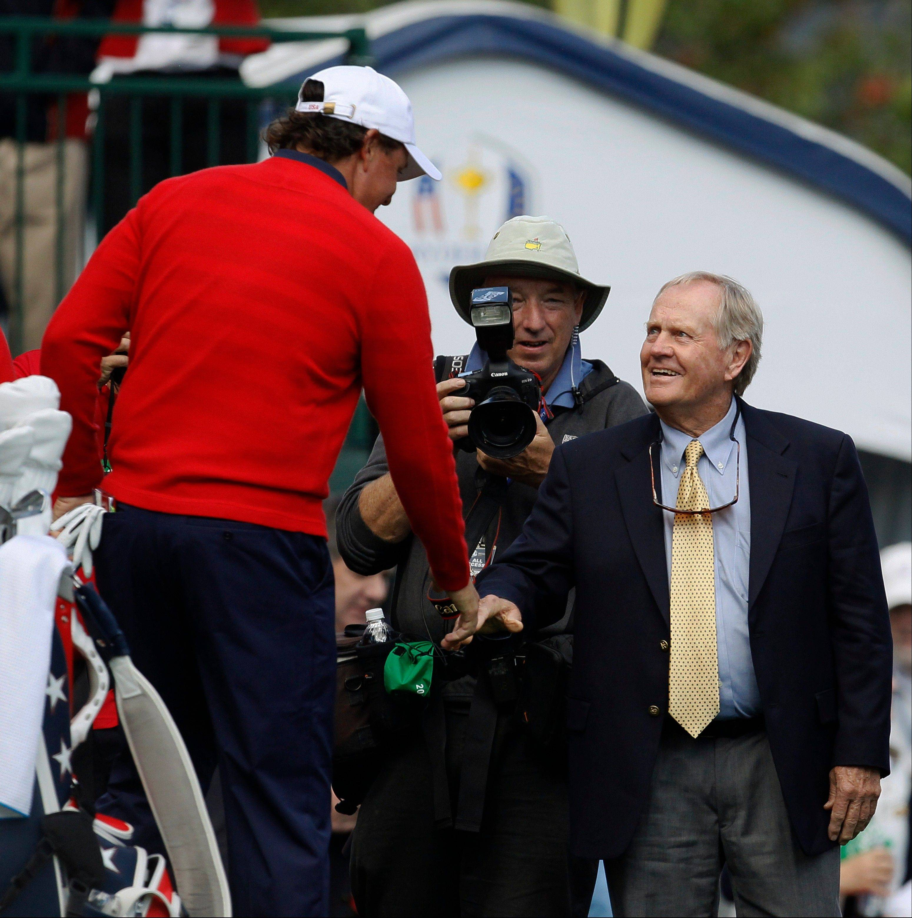 USA's Phil Mickelson, left, shakes hands with Jack Nicklaus on the first hole before a singles match at the Ryder Cup PGA golf tournament Sunday.