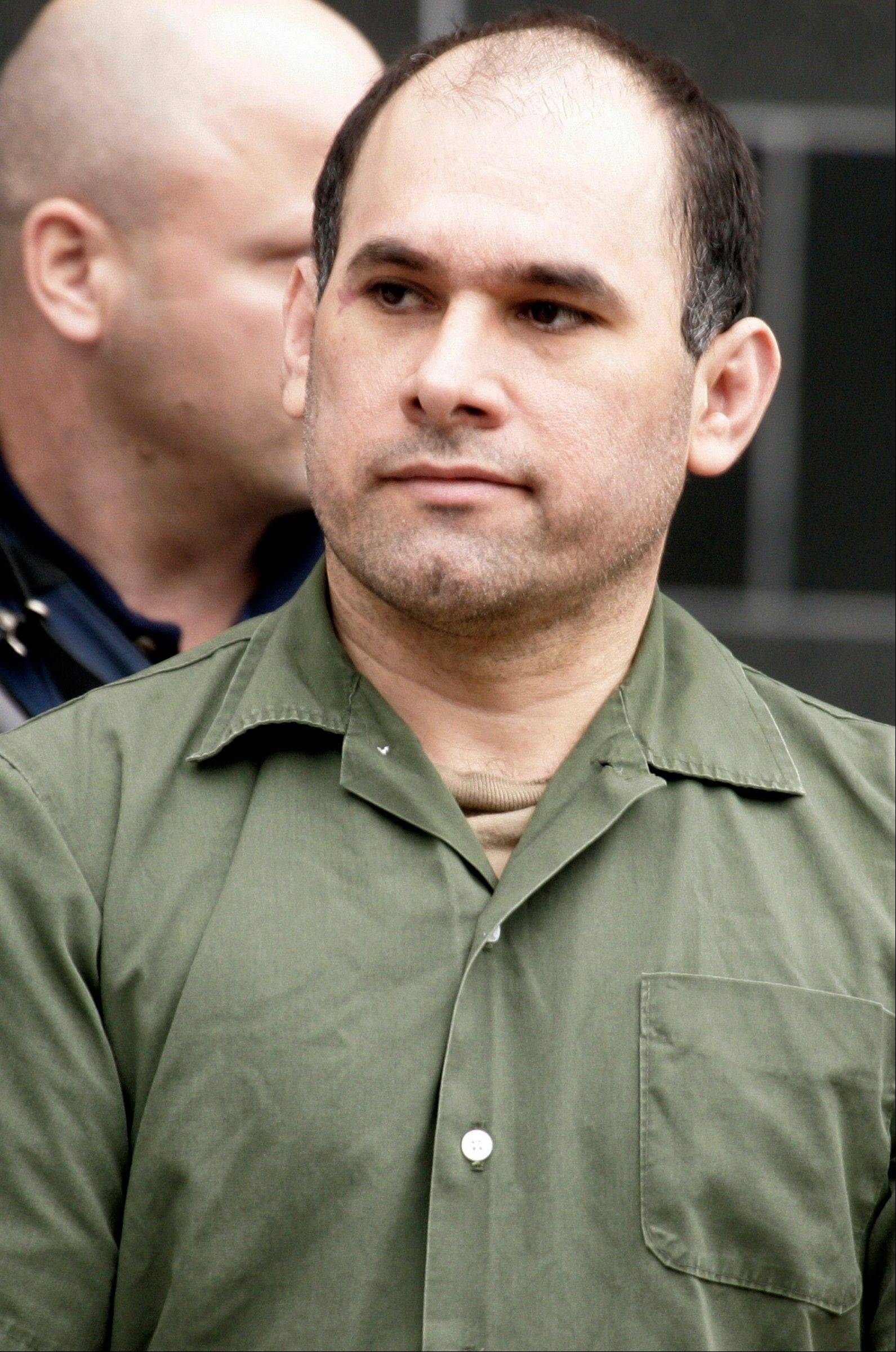 Accused Mexican drug kingpin Osiel Cardenas-Guillen, 39, leaves the federal courthouse in Houston after pleading not guilty to charges connected to running a cartel that at its height smuggled four to six tons of cocaine per month into the country.