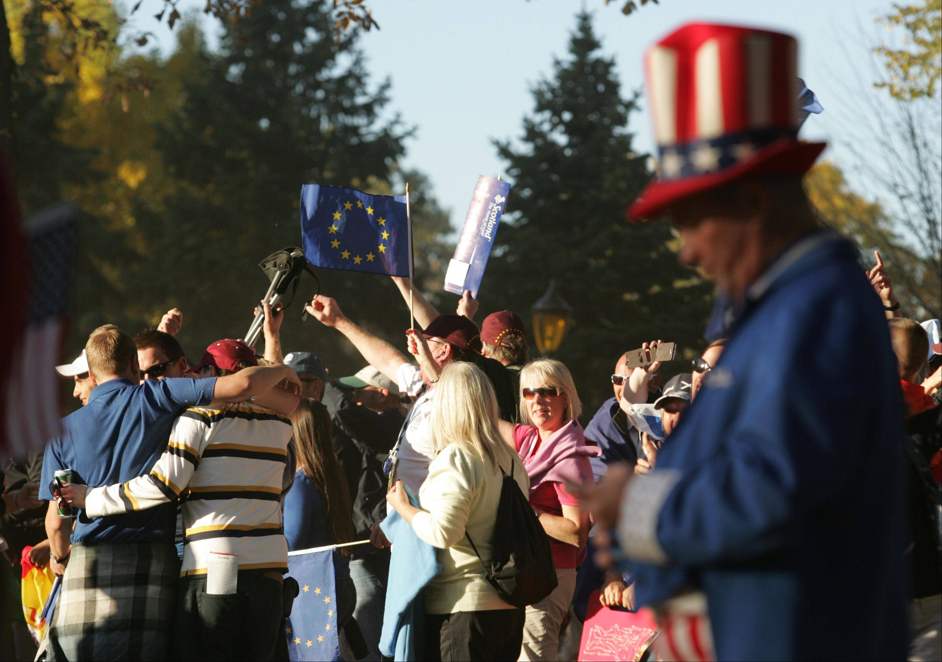 Dressed as Uncle Sam, Michael Sloan of Indianapolis, Indiana can't watch as Team Europe fans celebrate nearby Sunday evening in Medinah.