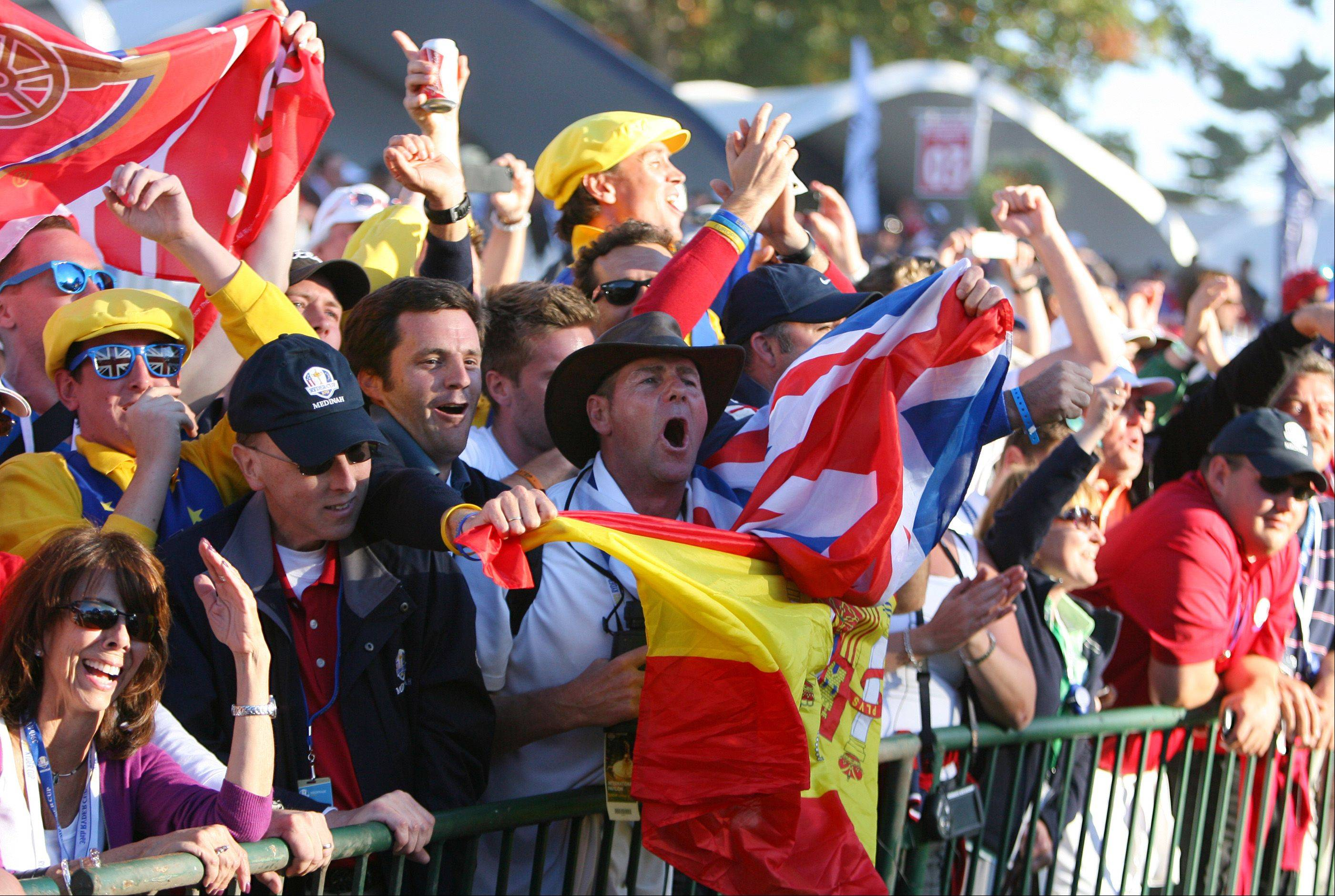 European fans celebrate after their team won the Ryder Cup Sunday in Medinah.