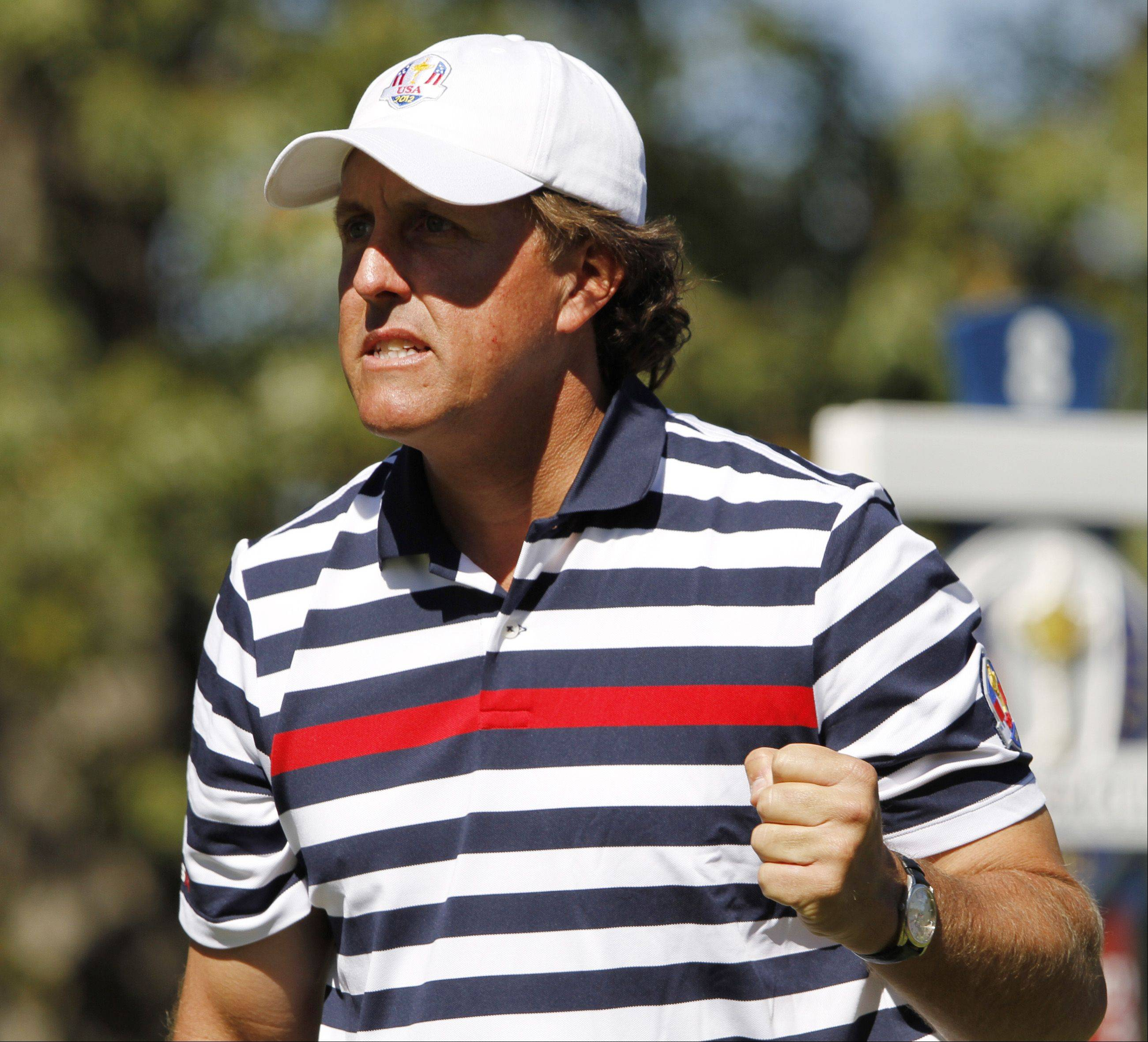 Phil Mickelson gets pumped after hitting a great tee shot on the par-3 8th.