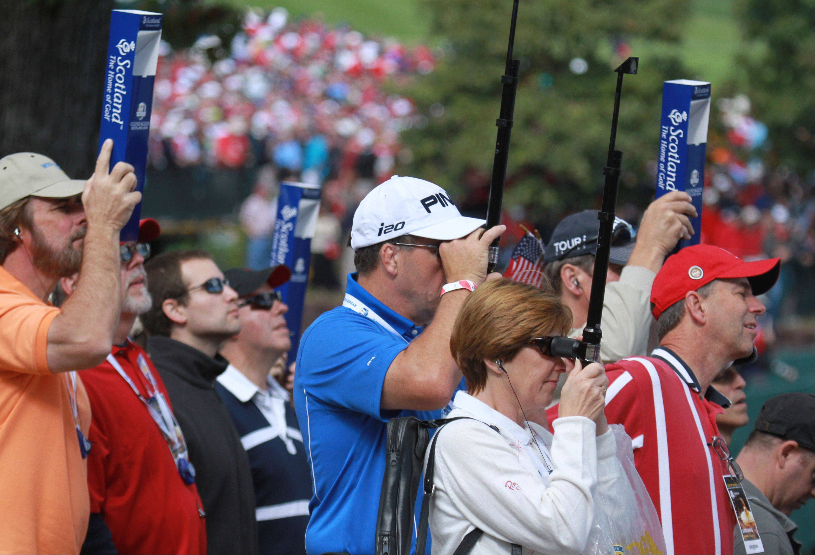 Fans found all sorts of ways to get a better view of the action Sunday at Medinah.