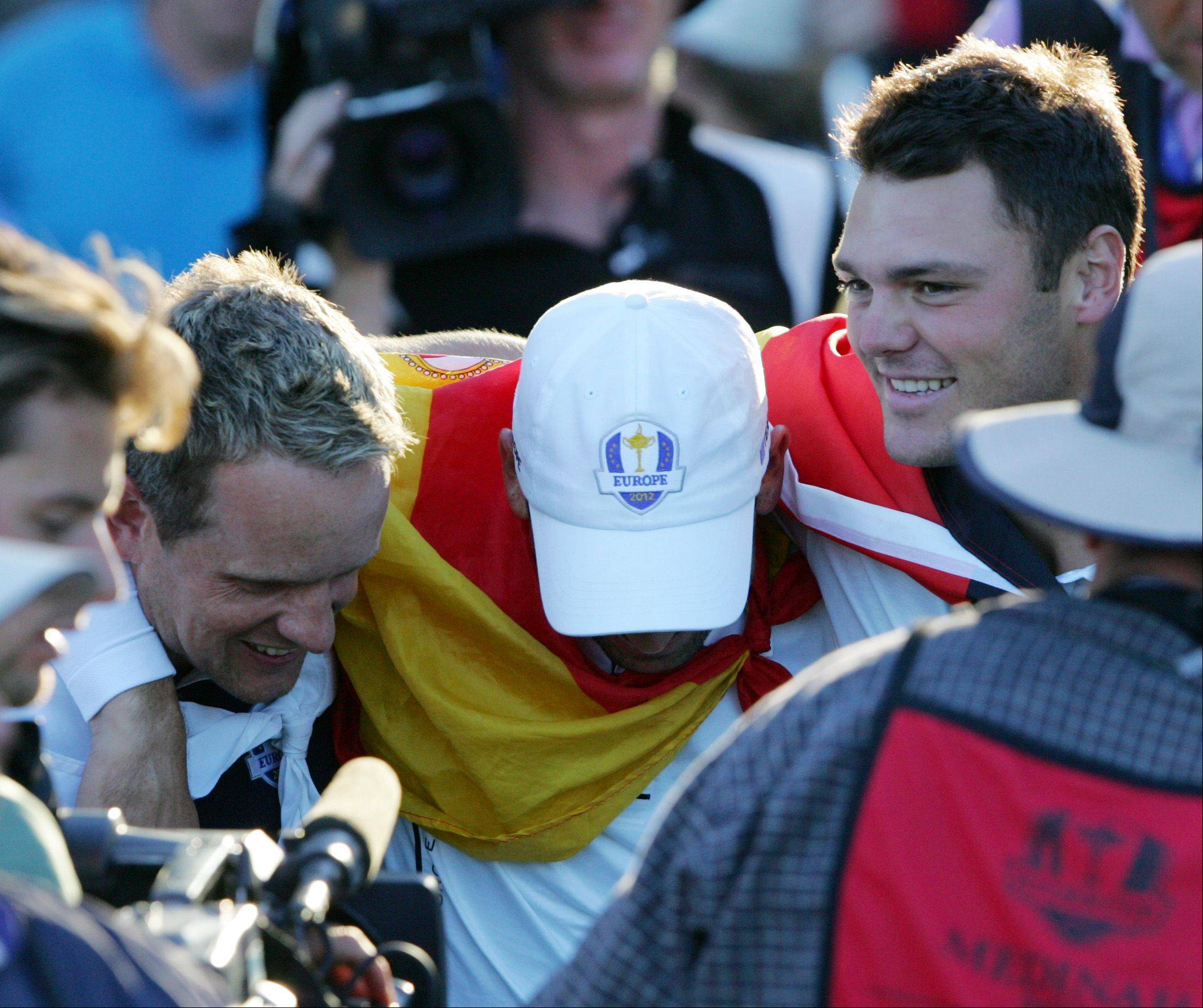 European teammates Luke Donald, left, Sergio Garcia and Martin Kaymer celebrate in Medinah Sunday after winning the Ryder Cup.