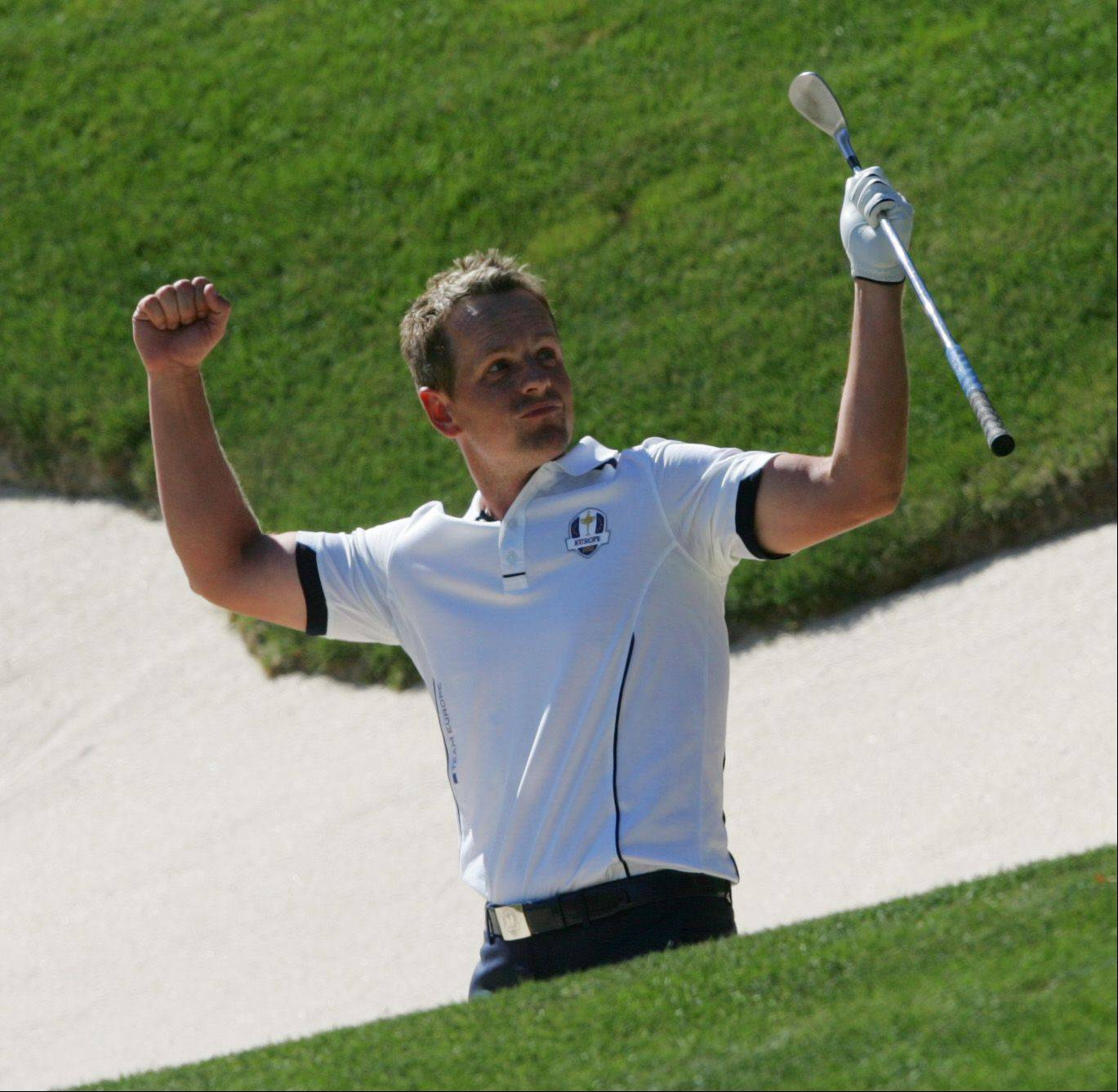 Team Europe's Luke Donald celebrates a clutch shot from the bunker on 17 during the singles matches of the Ryder Cup Sunday.