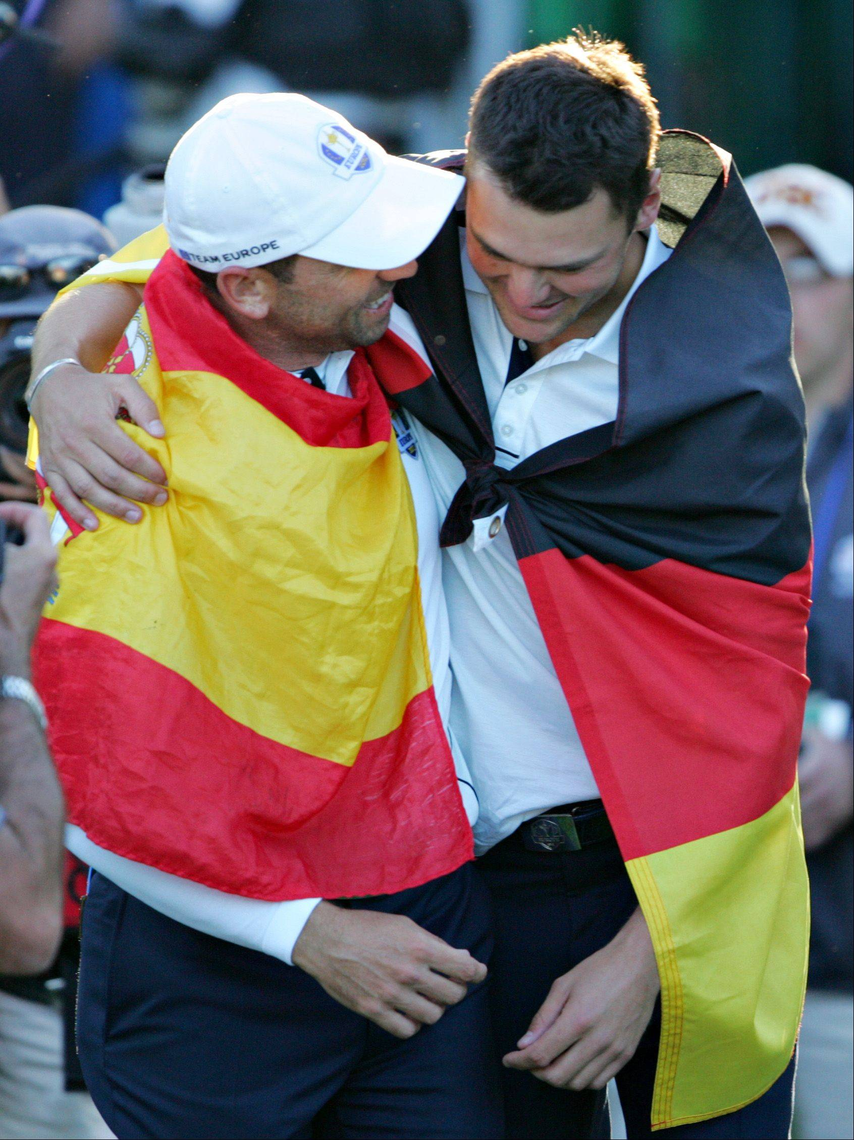 European teammates Sergio Garcia, left, and Martin Kaymer celebrate after their team's win Sunday in Medinah.