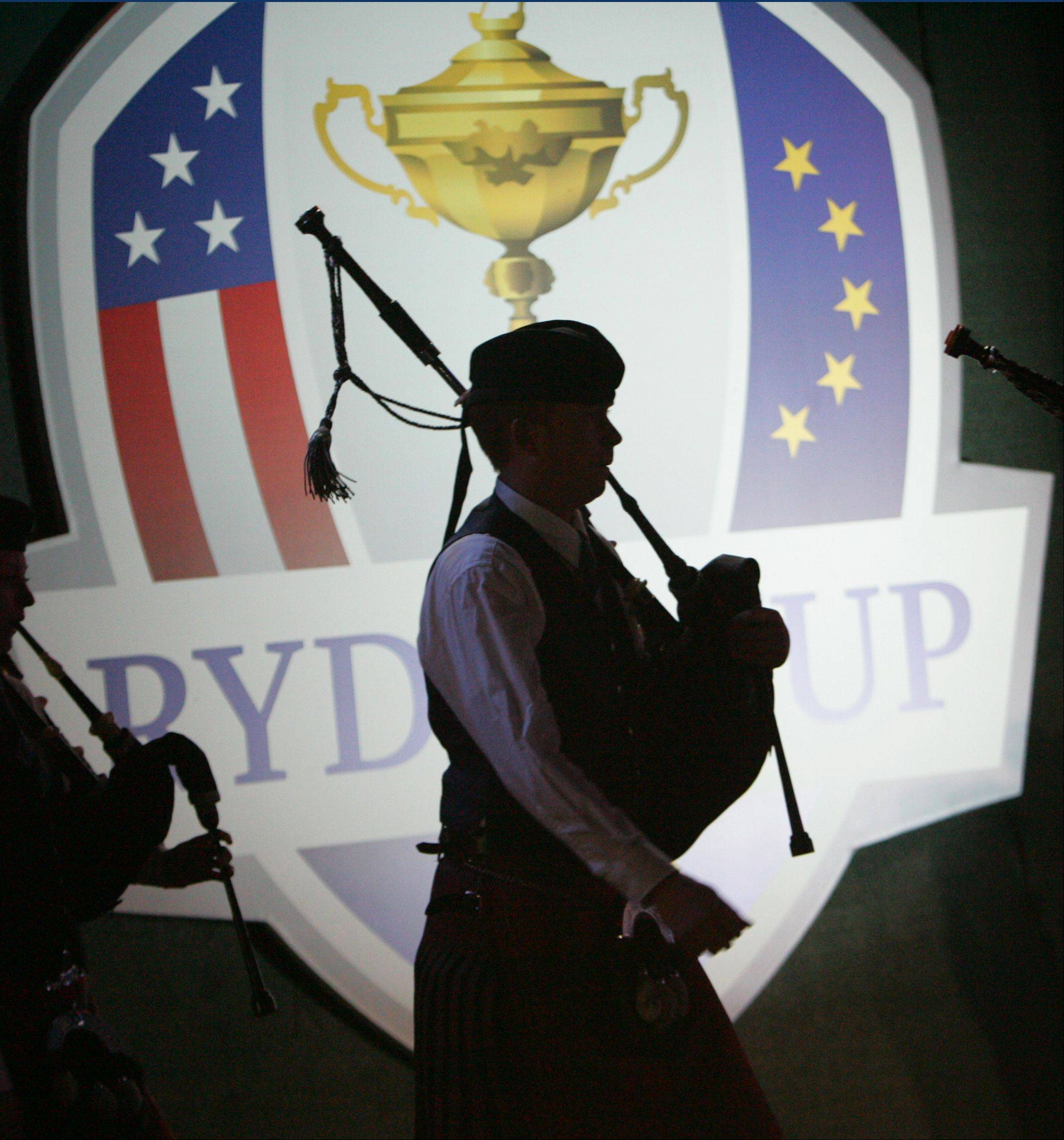 A bagpiper performs during the closing ceremonies of the Ryder Cup Sunday evening at Medinah Country Club