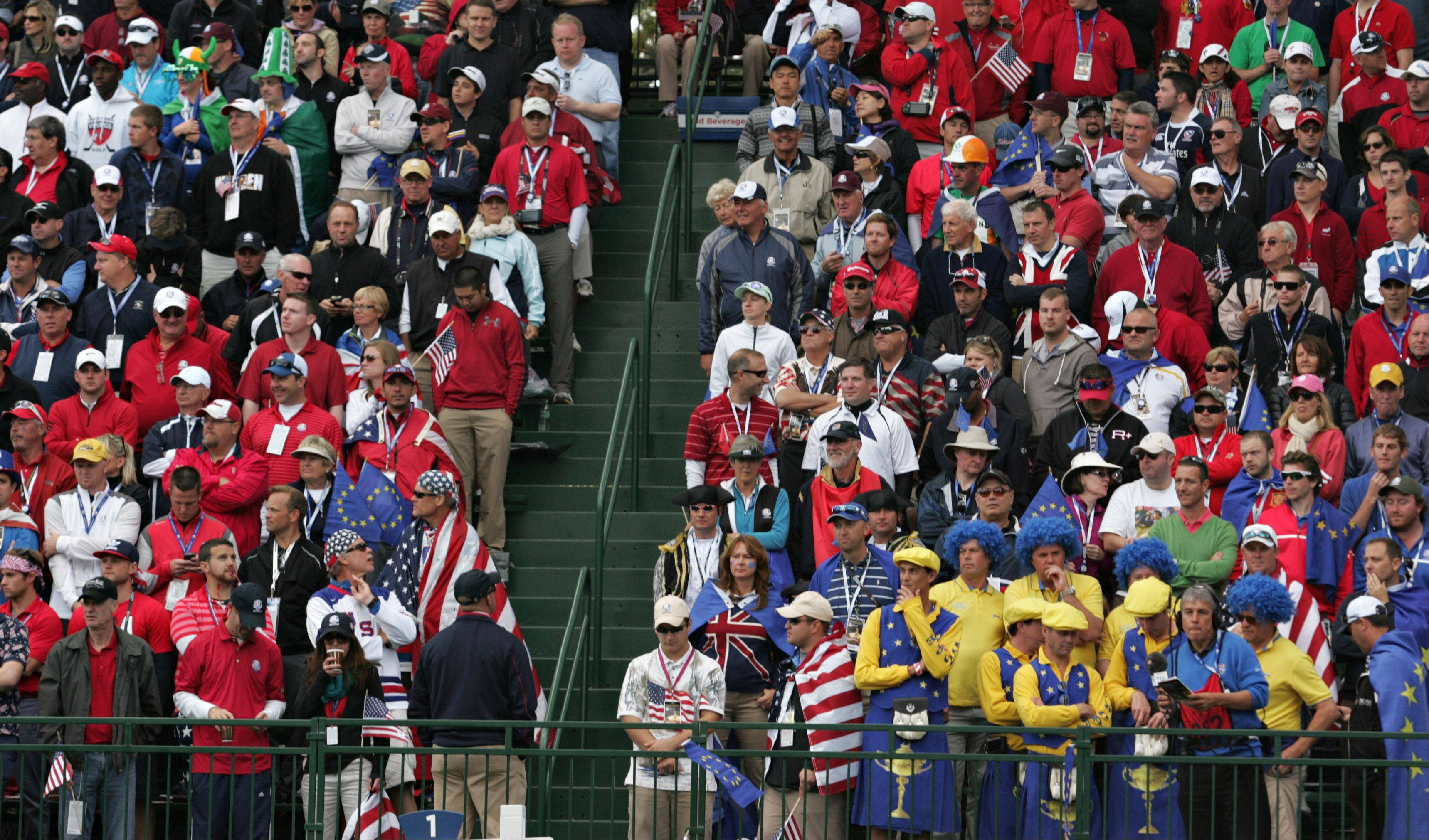 A small group of Team Europe fans are outnumbered by Team USA fans gathered in the grandstands at the first tee Sunday morning.