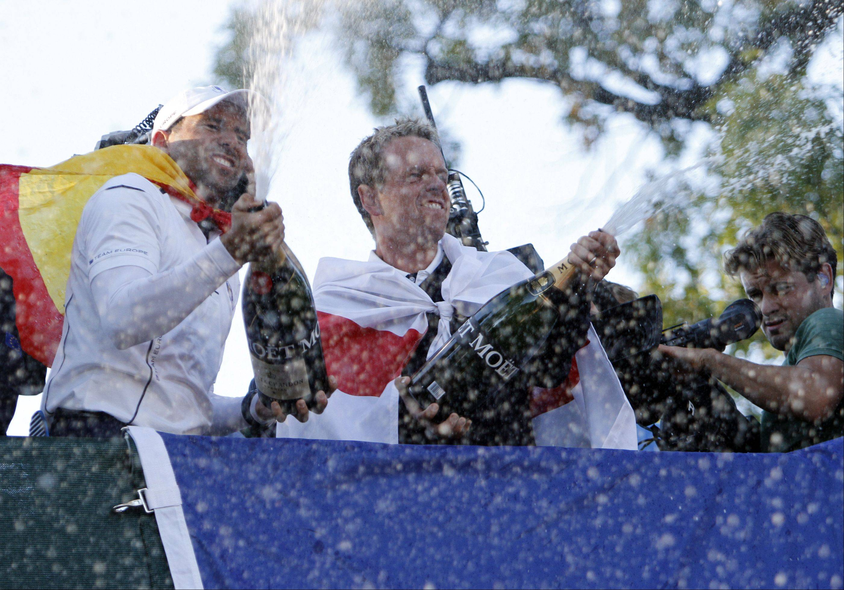 Sergio Garcia, left, and Luke Donald celebrate team Europe's win by spraying champagne on Sunday during the final day of the 2012 Ryder Cup at Medinah Country Club.
