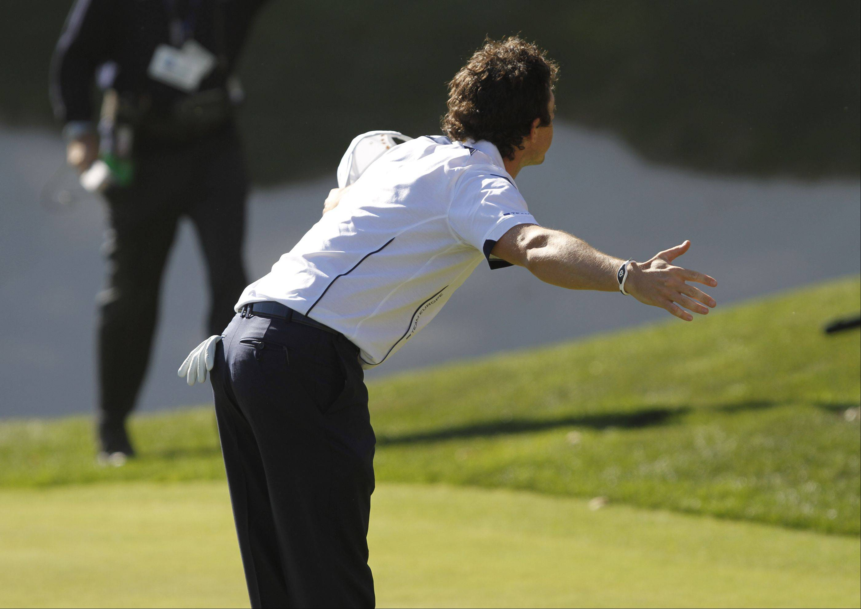 Rory McIlroy bows to the crowd at the 17th hole after defeating Keegan Bradley and taking a point for Europe Sunday during the final day of the 2012 Ryder Cup at Medinah Country Club.