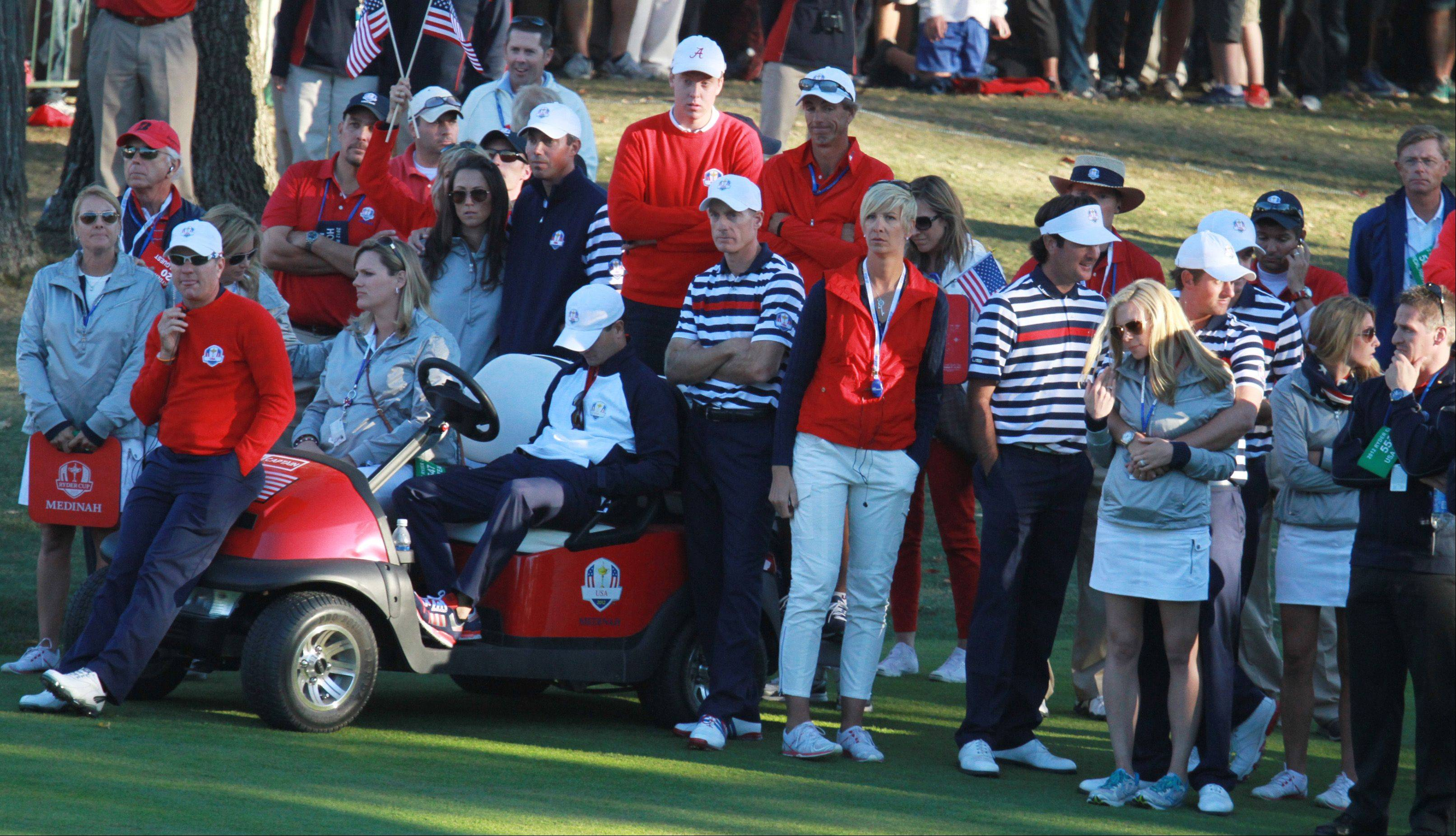 US team members and their families watch as the European team comes from behind and wins on 18.