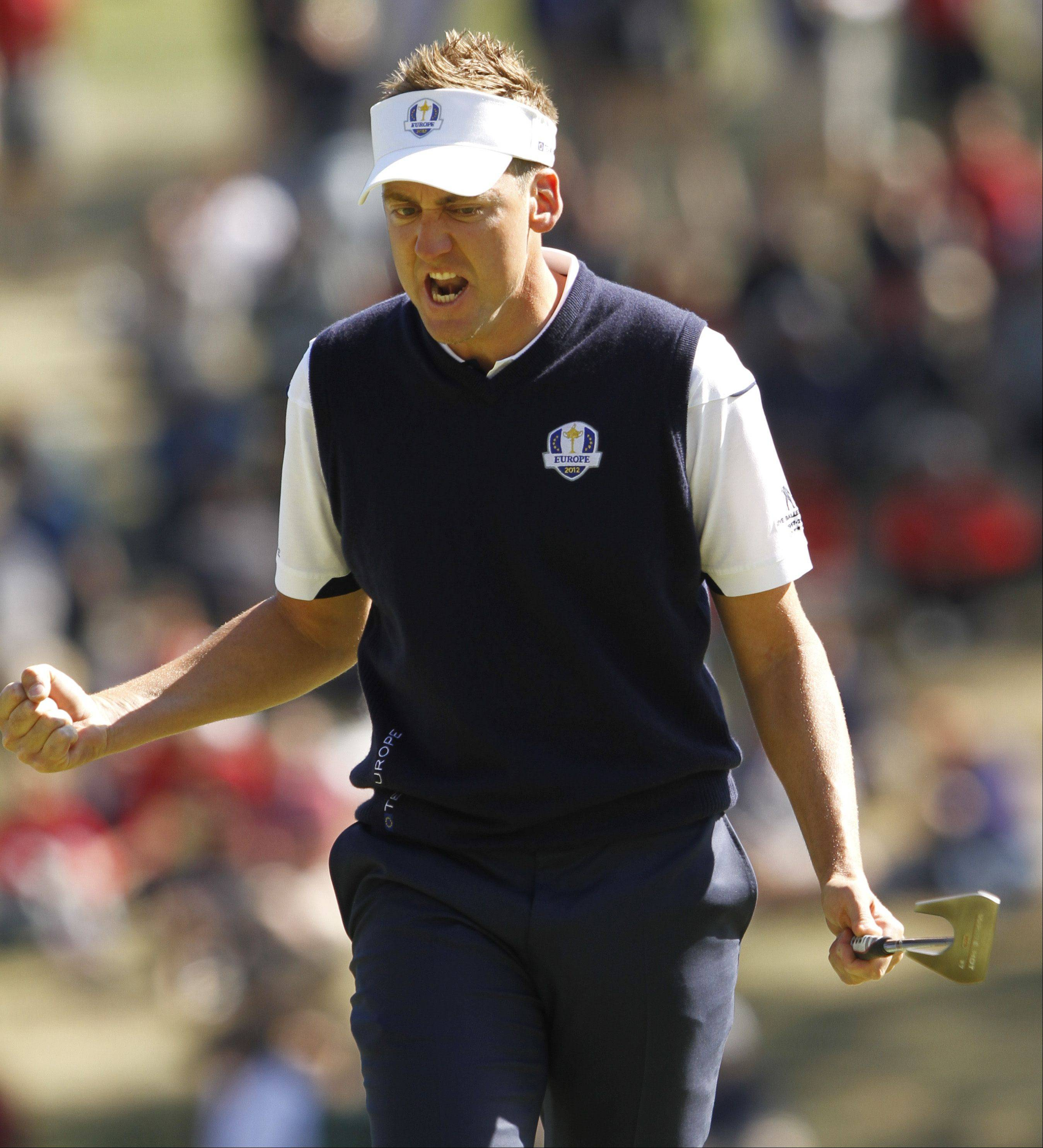 Ian Poulter, who won his singles match against Webb Simpson, gets fired up after making a putt Sunday afternoon.