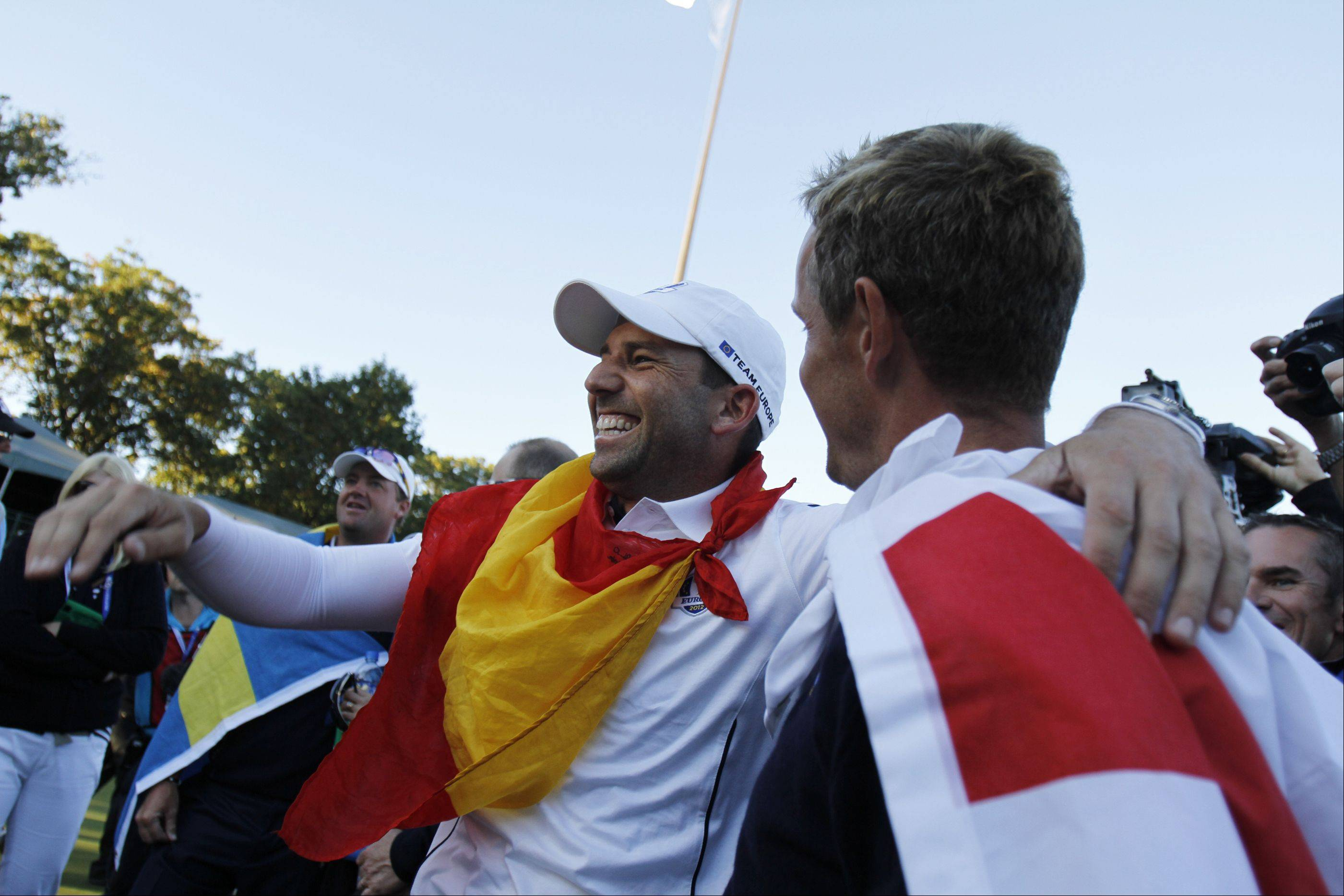 Sergio Garcia, left, and Luke Donald celebrate team Europe's win Sunday during the final day of the 2012 Ryder Cup at Medinah Country Club.