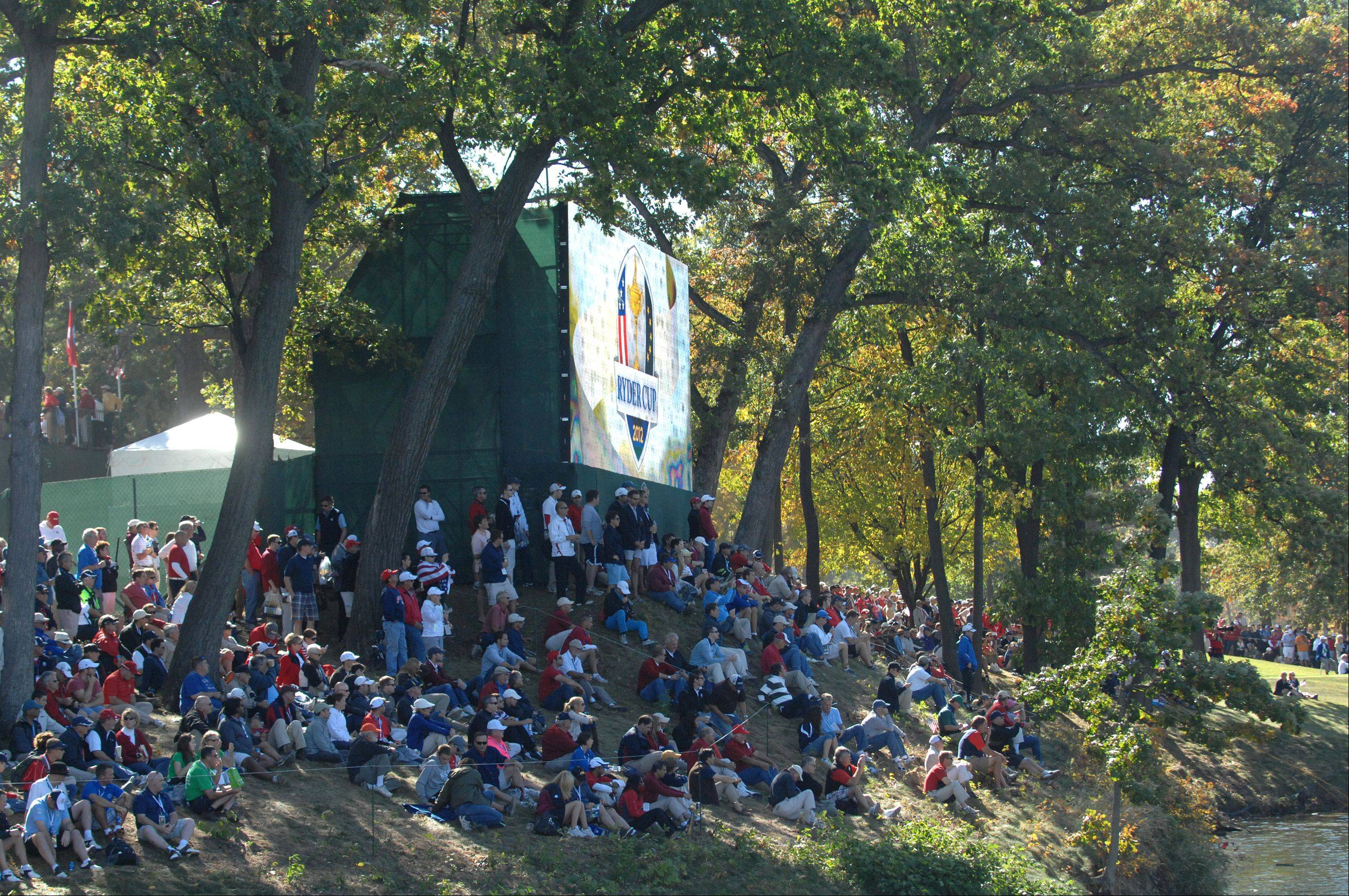 Fans stake out a spot across from the 13 hole Sunday during the final day of the 2012 Ryder Cup at Medinah Country Club.