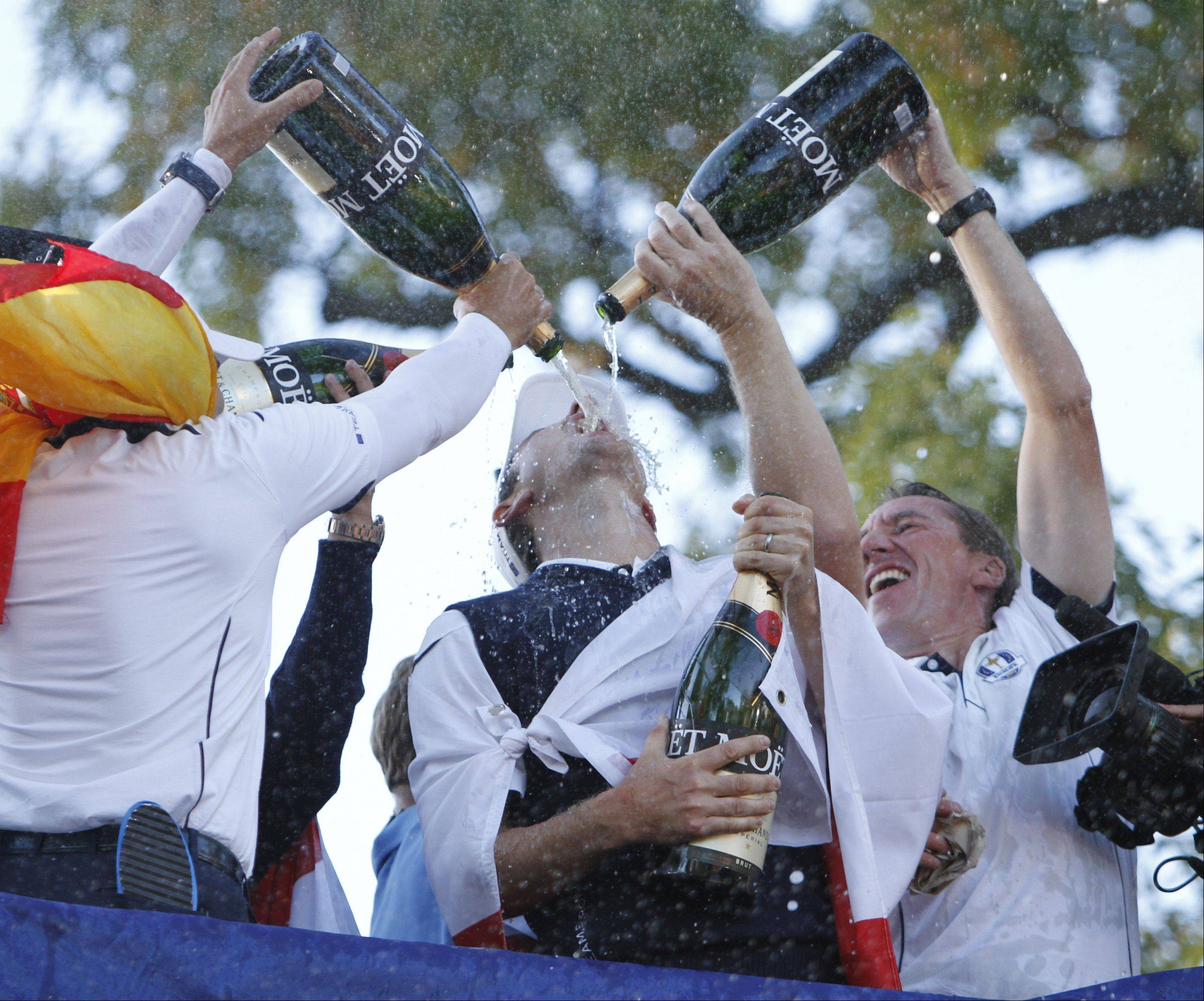 Team Europe members douse Justin Rose with champagne following their victory over the US Sunday during the final day of the 2012 Ryder Cup at Medinah Country Club.