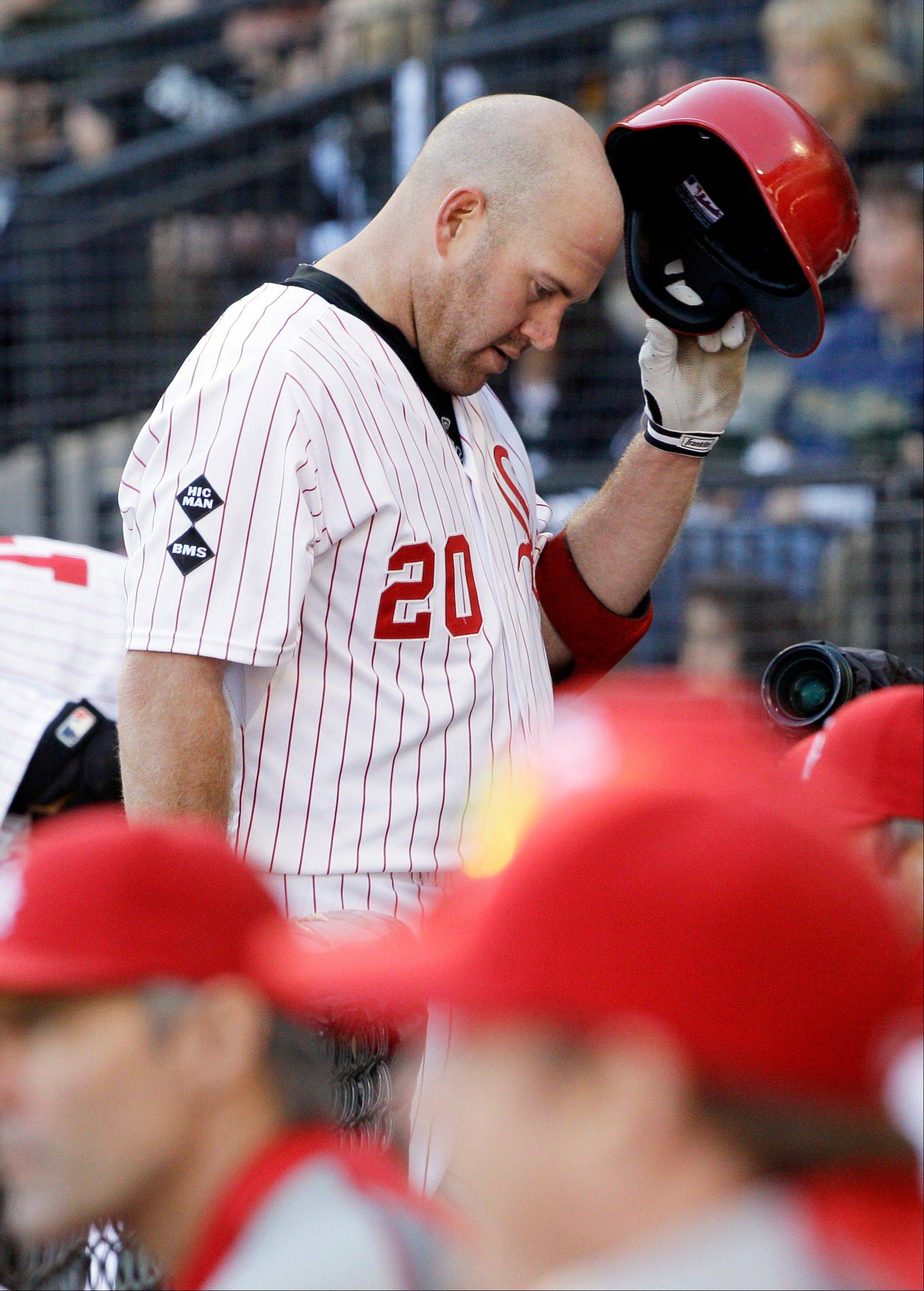 Kevin Youkilis looks down as he walks back to the dugout after striking out in the eighth inning Sunday at U.S. Cellular Field.