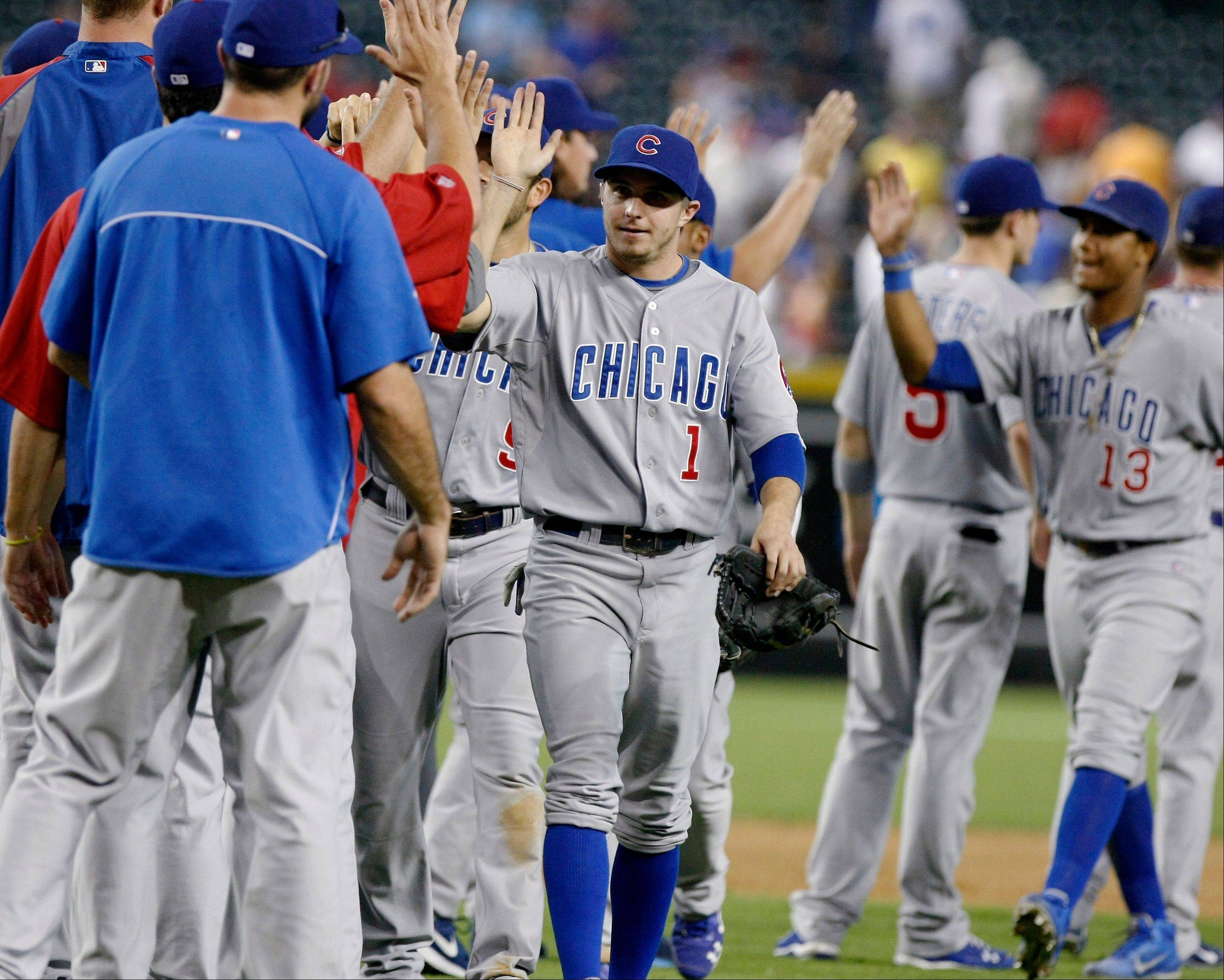 Cubs center fielder Tony Campana and teammates celebrate Sunday after defeating the Arizona Diamondbacks 7-2.