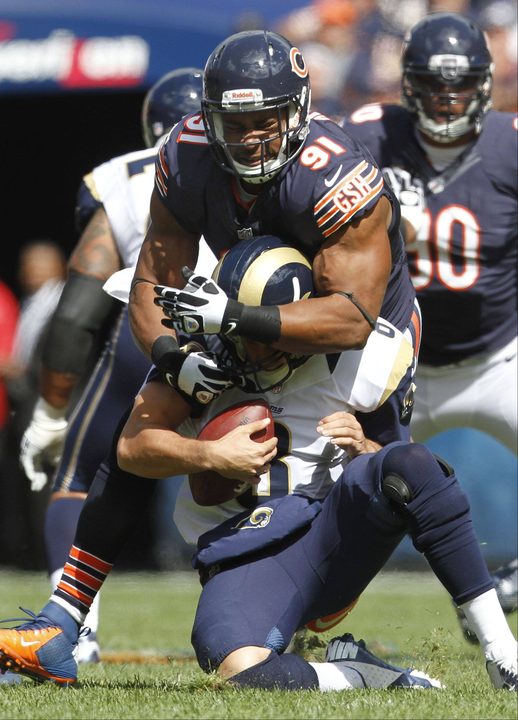 Bears defensive tackle Amobi Okoye sacks Rams quarterback Sam Bradford last Sunday. Thirteen of the Bears' 14 sacks through the first three games have come from the defensive line.