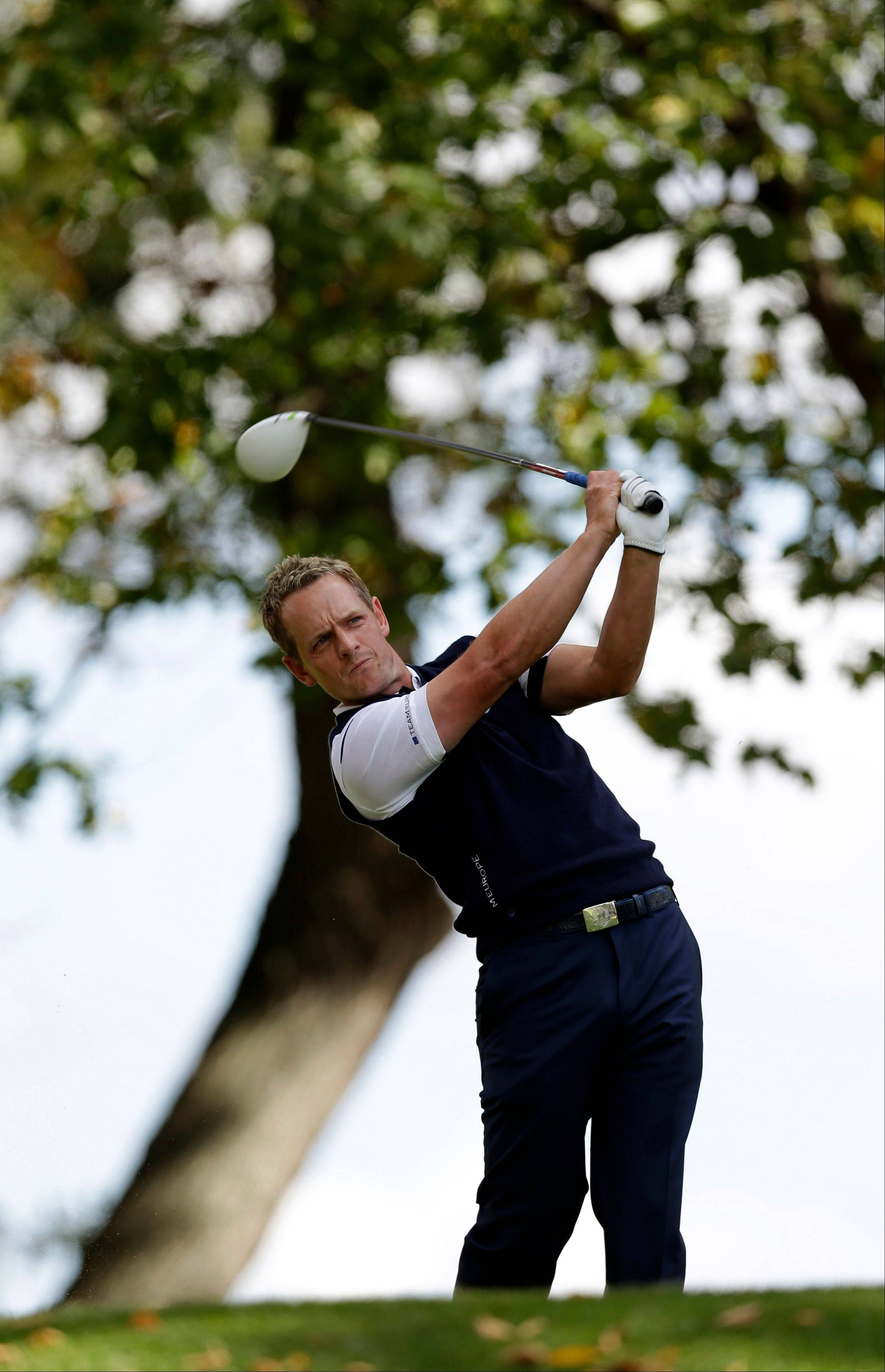 Europe's Luke Donald hits a drive on the third hole in his Ryder Cup match Sunday.