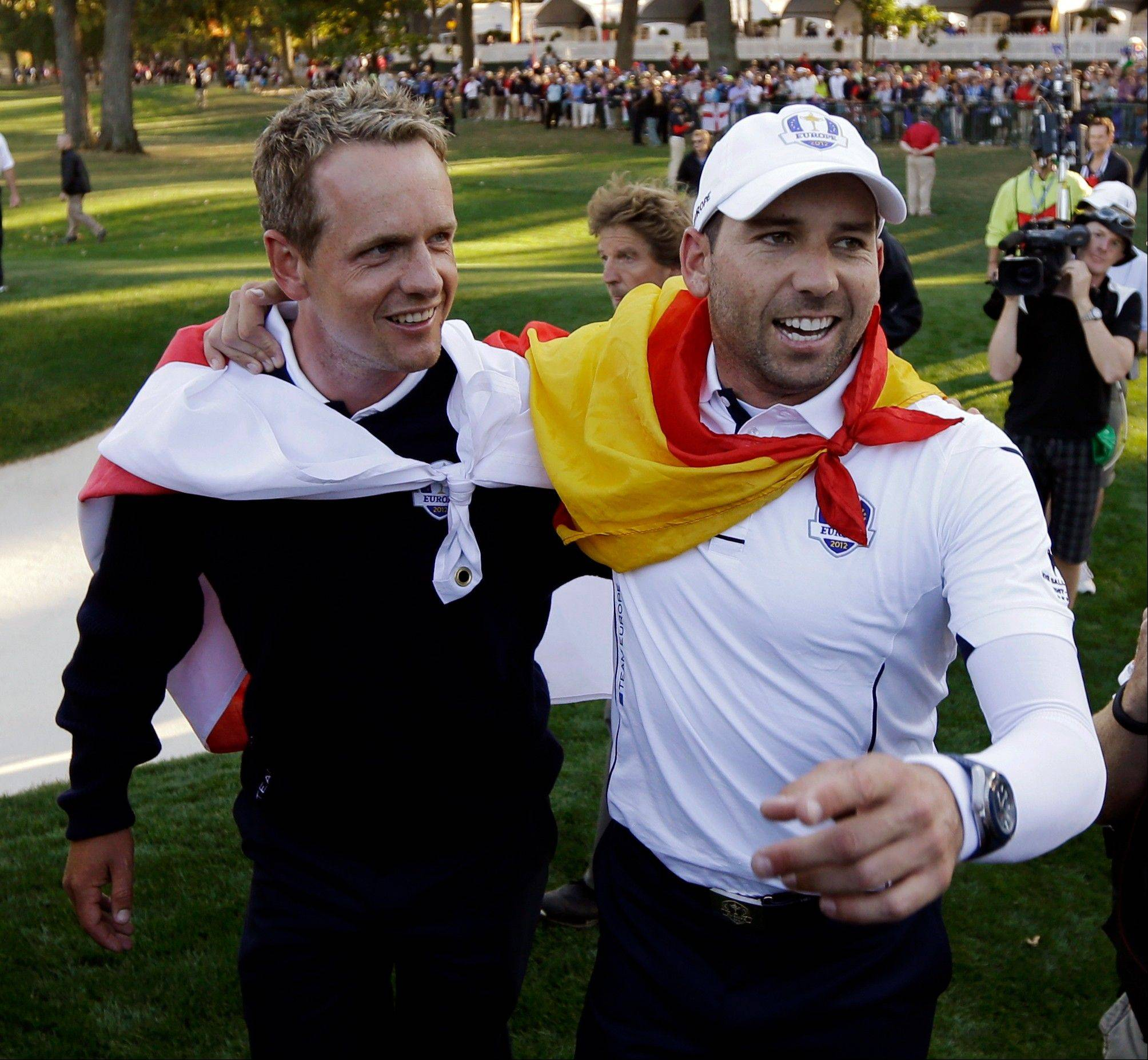 Europe's Sergio Garcia, right, and Luke Donald celebrate after winning the Ryder Cup Sunday at Medinah Country Club.